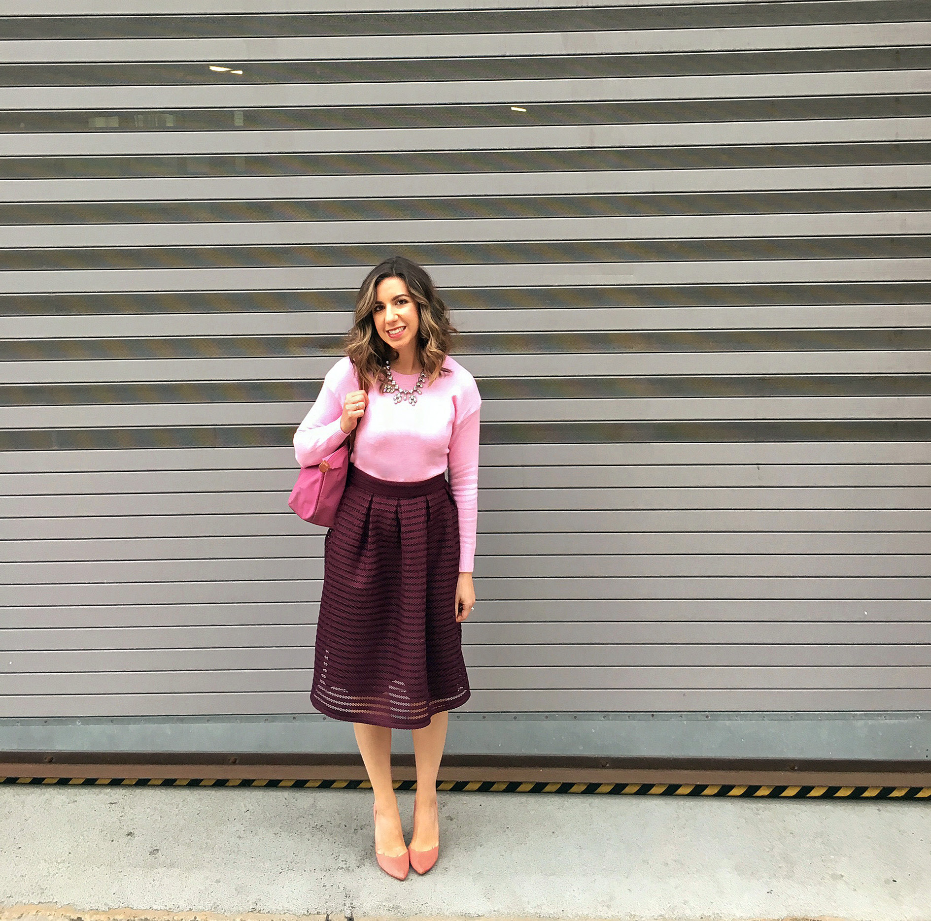 Pink Valentines Day Look featured by top US fashion blog, Glass of Glam: image of a woman wearing a pink SheIn sweater, Charlotte Russe midi skirt, pink Longchamp bag, JustFab heels, and a BaubleBar statement necklace