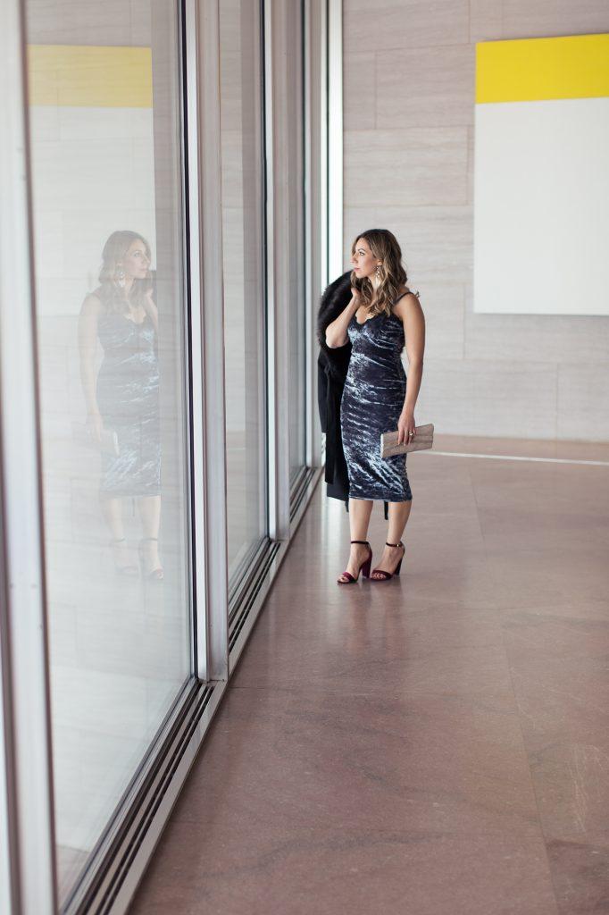 Lifestyle Blogger Glass of Glam Wearing Blue Boohoo Velvet Slip Dress, faux fur coat, and red velvet strappy heels