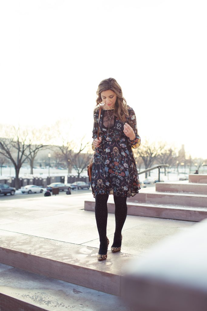 Lifestyle blogger Roxanne Birnbaum of Glass of Glam wearing SugaraLips Jude floral dress and Express tights