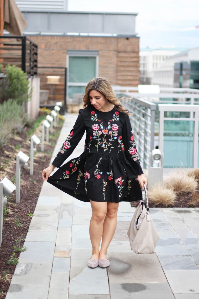 Lifestyle Blogger Roxanne Birnbaum of Glass of Gla wearing a Zaful embroidered black dress, Cuore & Pelle hobo bag, and M.Gemi flats