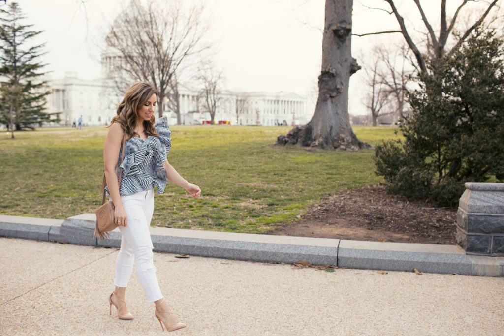Lifestyle Blogger Roxanne of Glass of Glam wearing a Blush & Stone Boutique ruffled gingham top, Old Navy denim, Christian Louboutin heels, and a Gucci Soho Disco bag