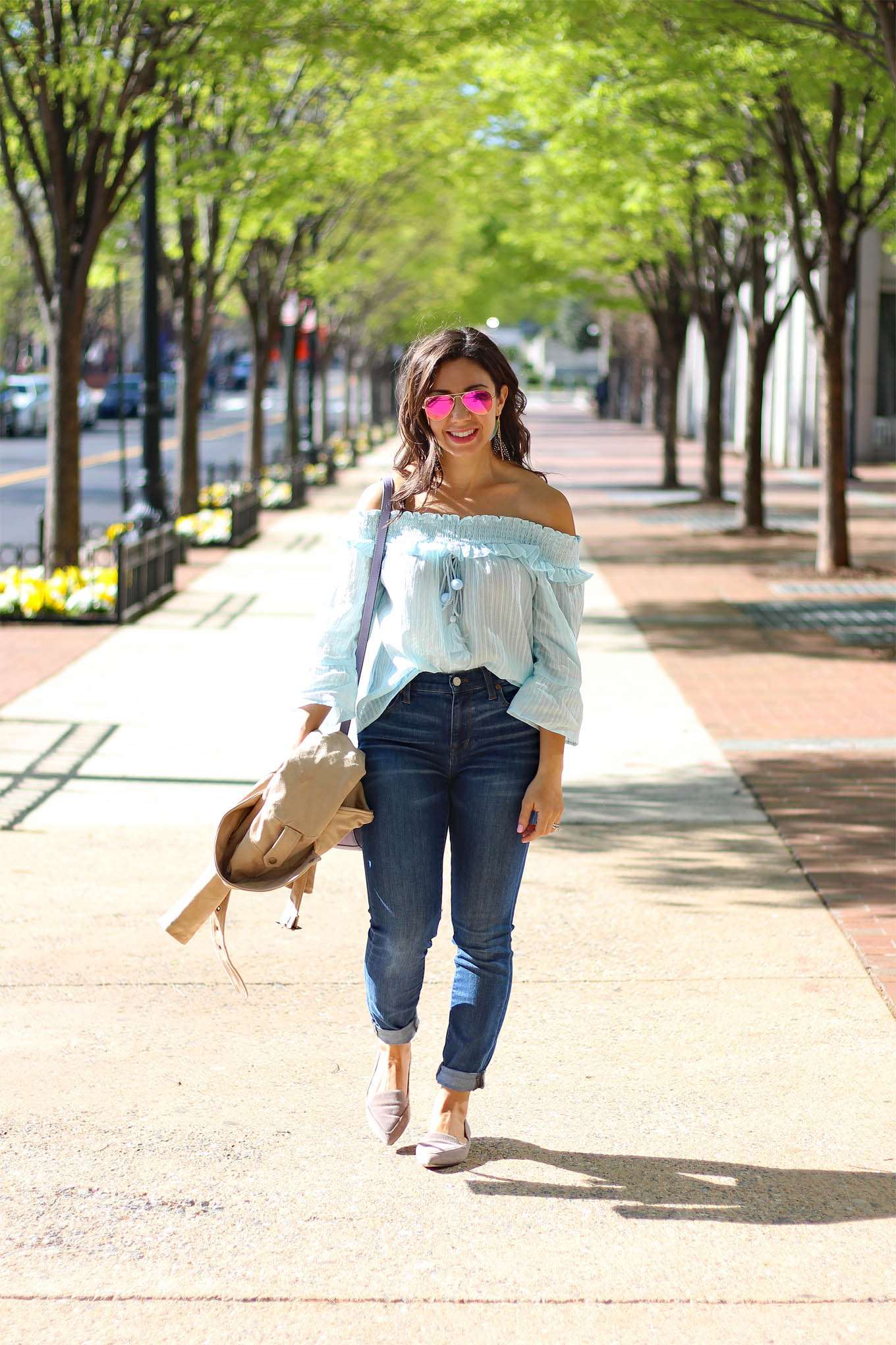 Lifestyle Blogger Roxanne of Glass of Glam wearing a sky blue sugarlips top, Tobi faux suede jacket, M.Gemi Flats, Madewell denim, and a Justfab bag