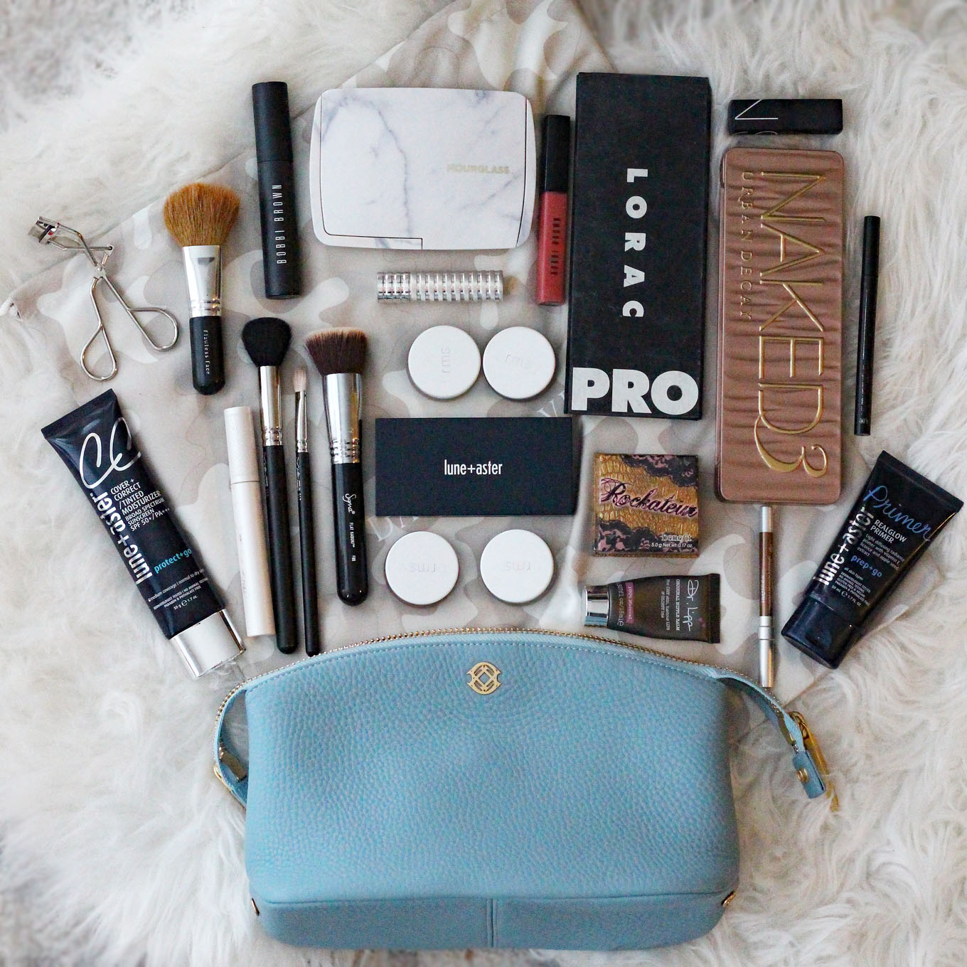 Lifestyle Blogger Roxanne of Glass of Glam's Review of the Dagne Dover Lola Pouch