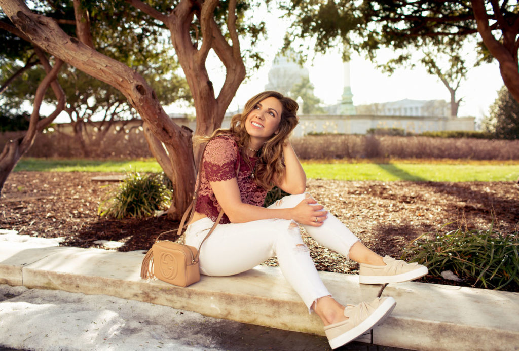 Lifestyle Blogger Roxanne of Glass of Glam wearing blush sneakers and a lace crop top