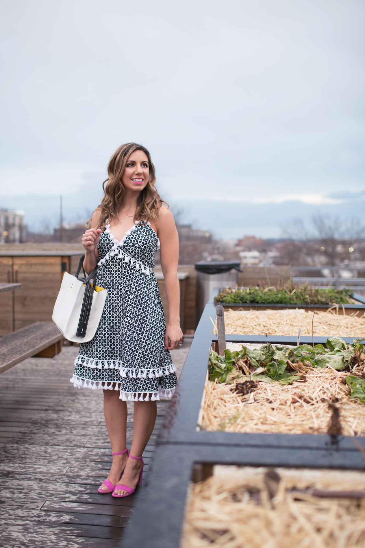 Lifestyle blogger Roxanne of Glass of Glam wearing a Blush and Stone tassel dress and pink heels