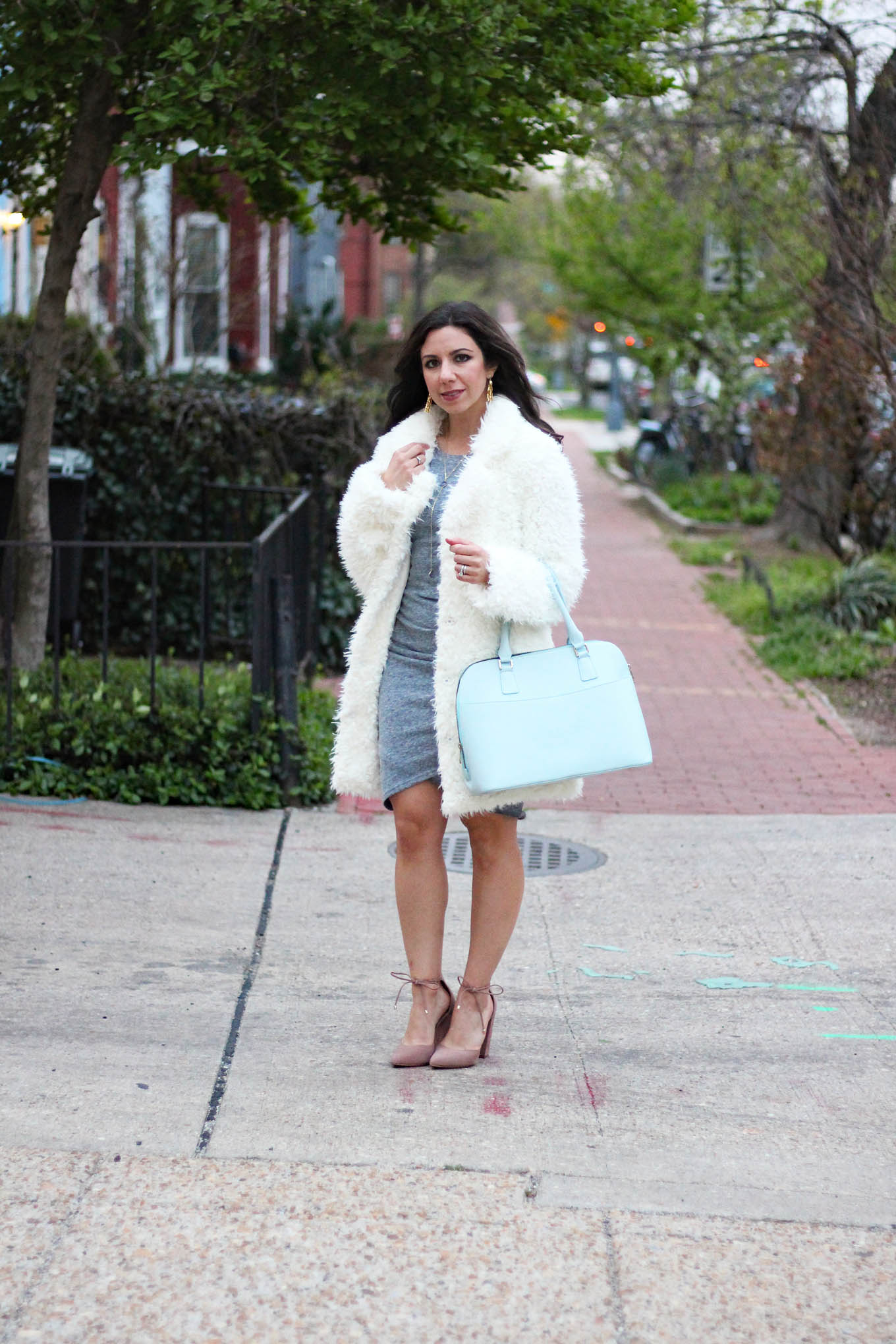 Lifestyle blogger Roxanne of Glass of Glam wearing a Boohoo shaggy coat, Mel Boteri bag, Nordstrom dress, Baublebar star earrings and Steve Madden Shoes
