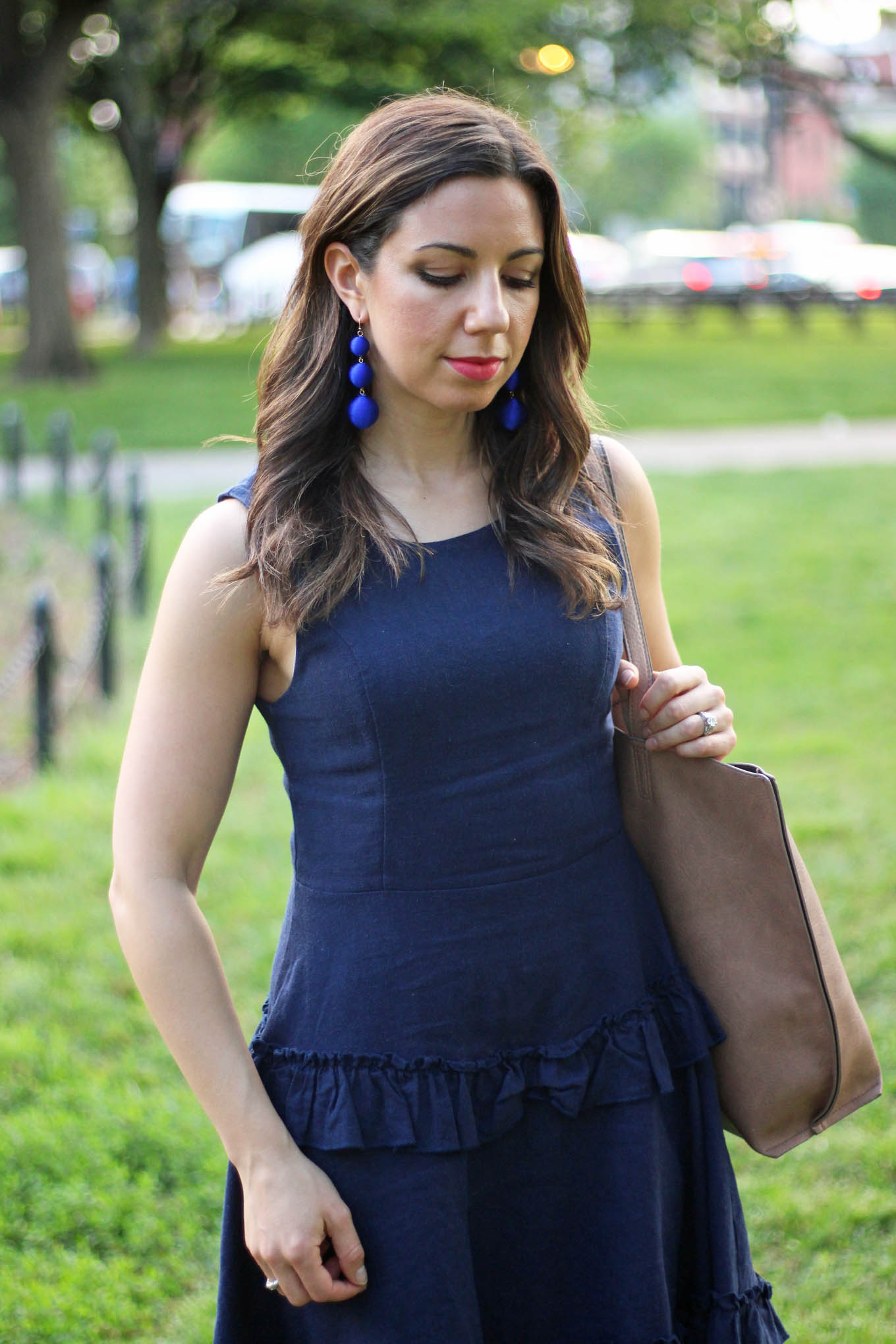 Lifestyle blogger Roxanne of Glass of Glam wearing a blue linen Francesca's dress, M.Gemi heels, Baublebar crispin drops, and a justfab bag
