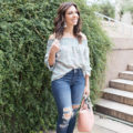 lifestyle blogger Roxanne of Glass of Glam wearing a wild blue denim floral top, express denim, cuore and pelle bag, diff eyewear sunnies, baublebar earrings, and a vintage silk scarf