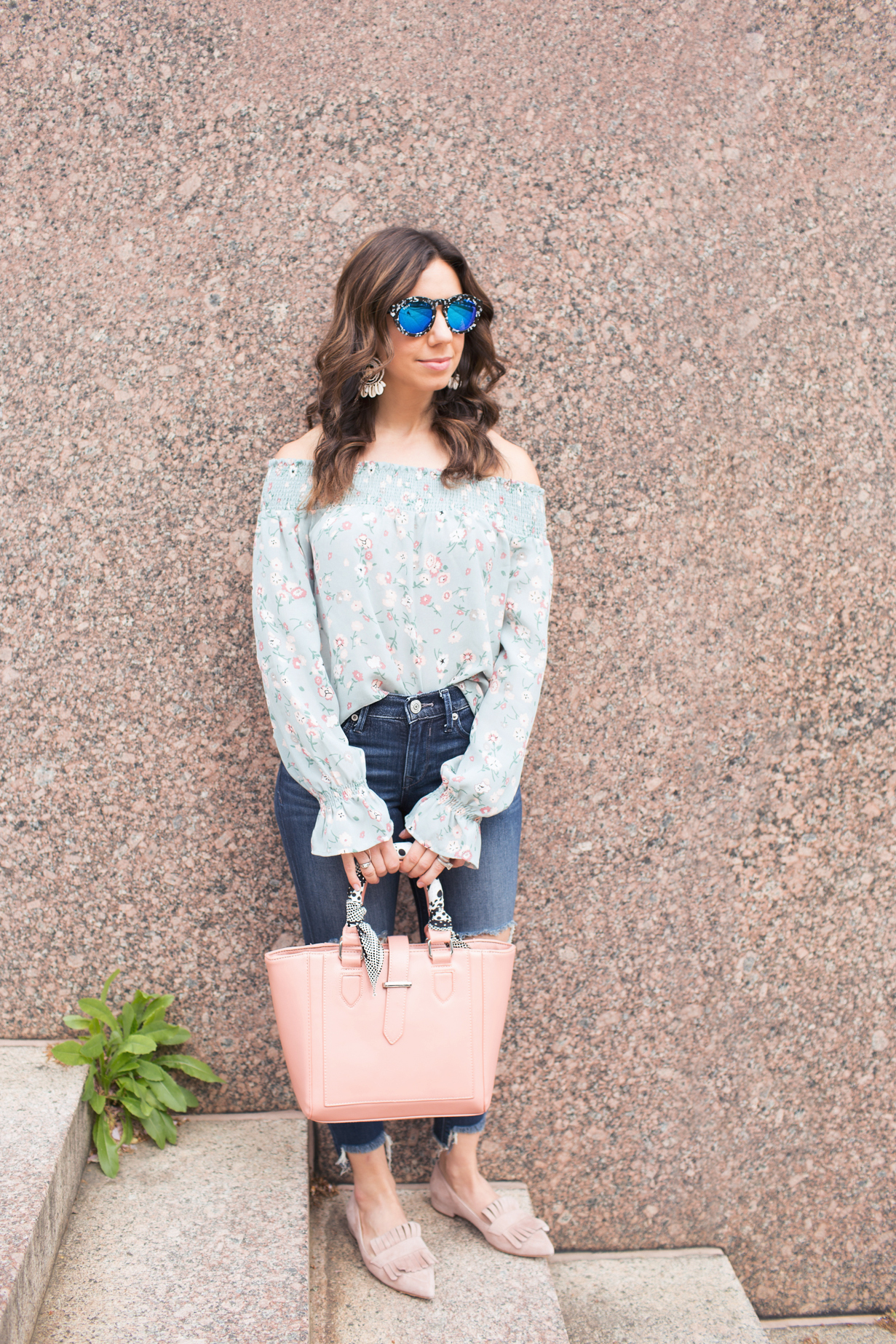 lifestyle blogger Roxanne of Glass of Glam wearing a wild blue denim floral top, express denim, cuore and pelle bag, diff eyewear sunnies, and baublebar earrings