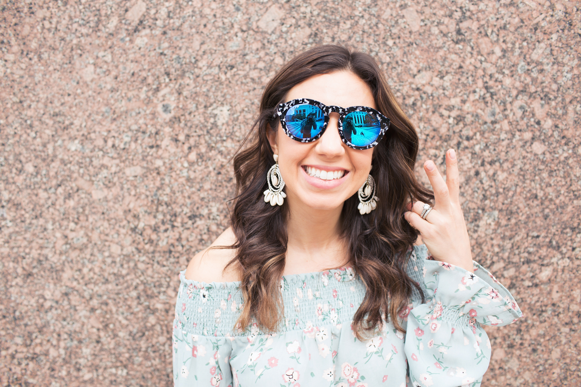 lifestyle blogger Roxanne of Glass of Glam wearing a wild blue denim floral top, express denim, diff eyewear sunnies, and baublebar earrings