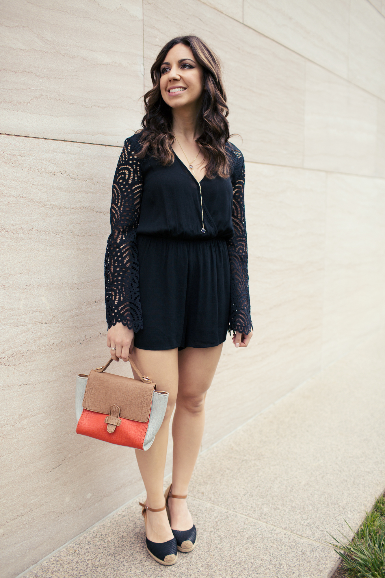 Lifestyle blogger Roxanne of Glass of Glam wearing a Sugarlips Romper and Zaful bag