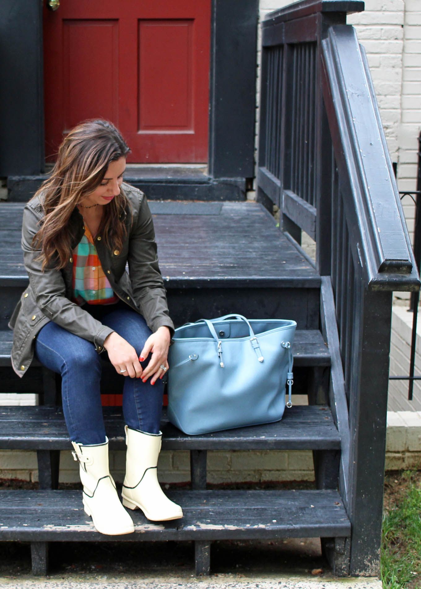 Lifestyle blogger Roxanne of Glass of Glam wearing white Chooka rain boots