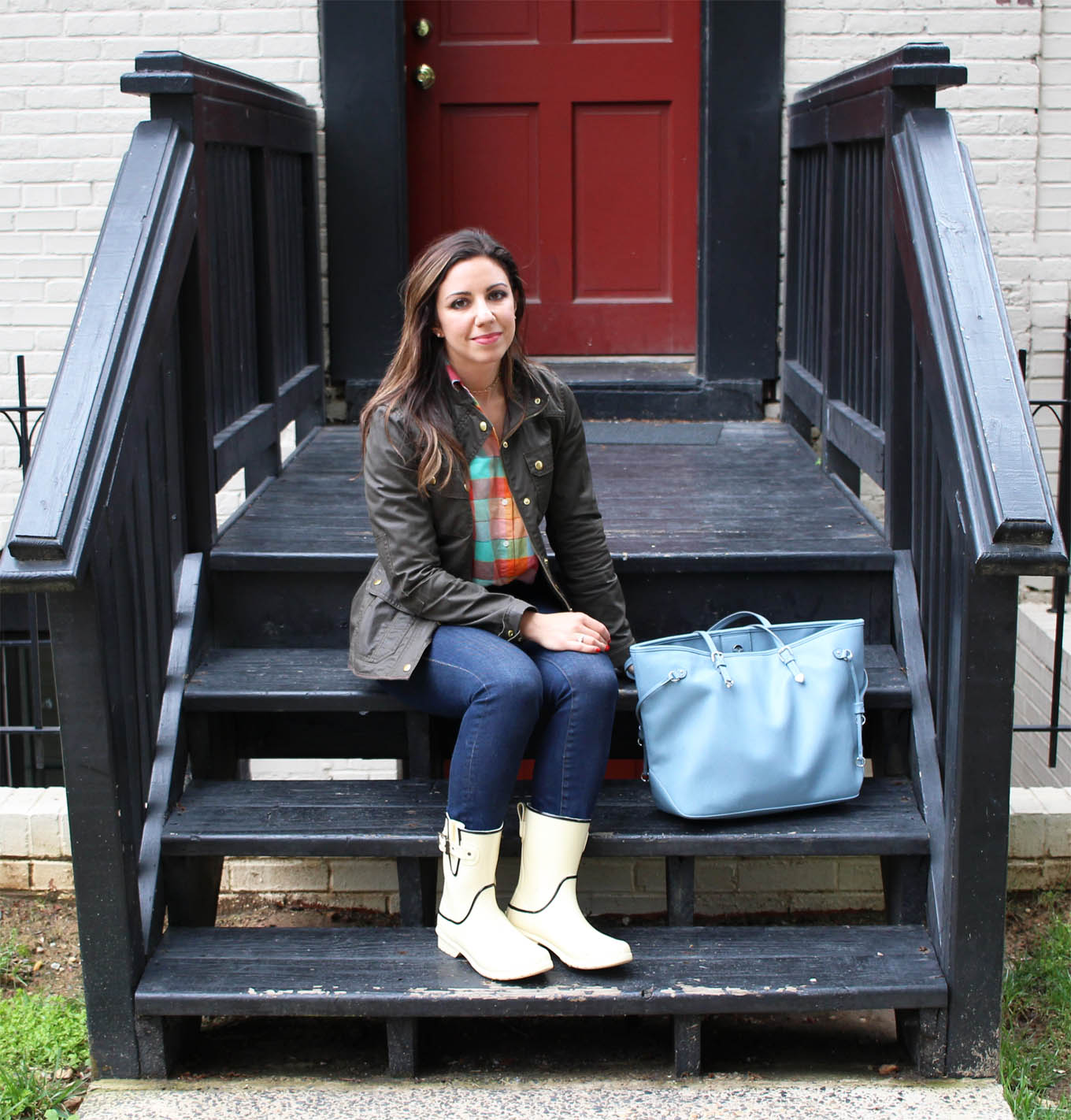 Lifestyle blogger Roxanne of Glass of Glam wearing white Chooka rain boots