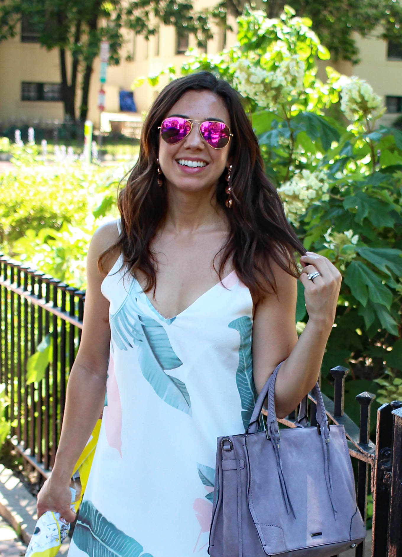 Lifestyle blogger Roxanne of Glass of Glam wearing a shein palm print dress and a rebecca minkoff satchel