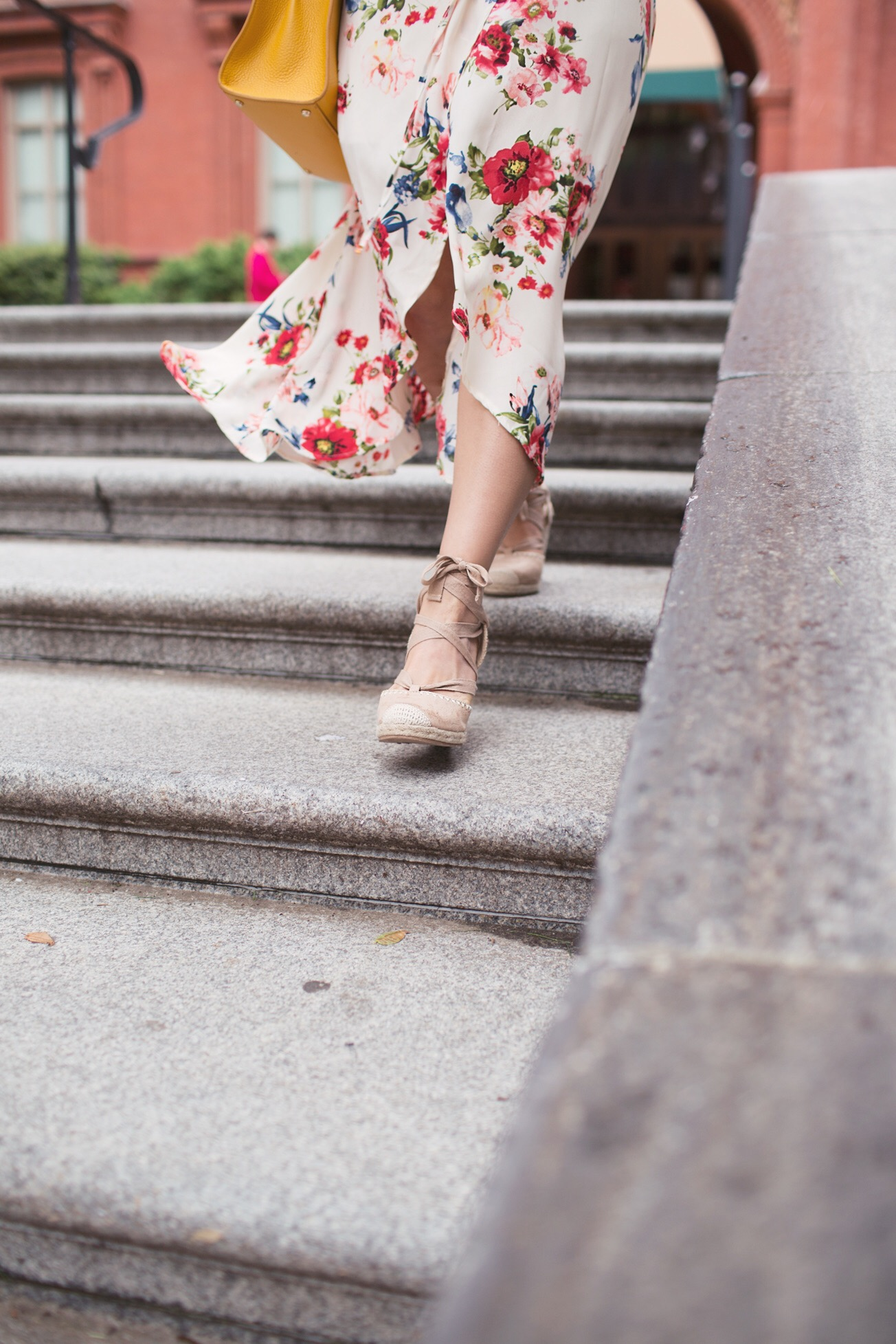 Lifestyle blogger Roxanne of Glass of Glam wearing a Xehar floral wrap print dress and lace up espadrilles