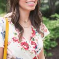 Lifestyle blogger Roxanne of Glass of Glam wearing a Xehar floral wrap print dress and a dainty Midori Linea necklace