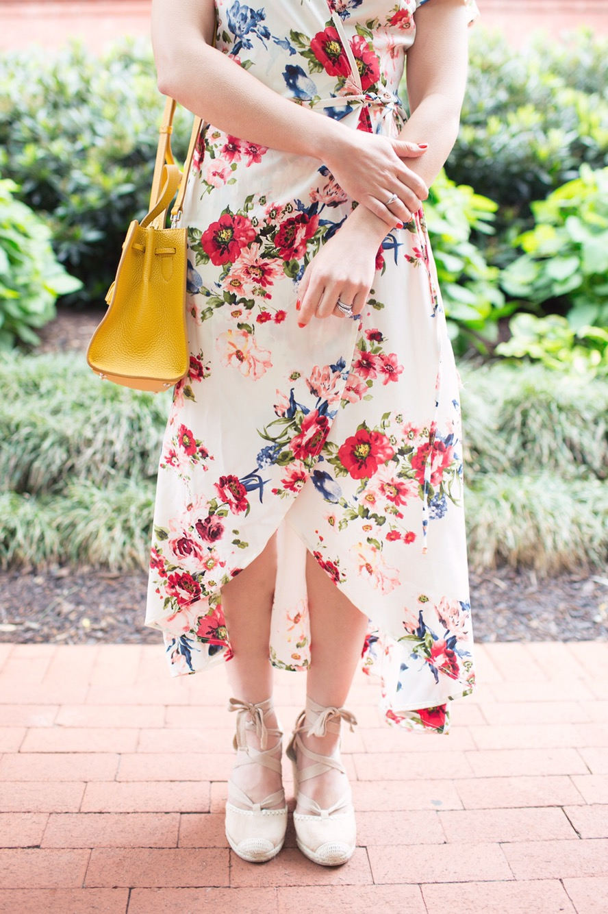 Lifestyle blogger Roxanne of Glass of Glam wearing a Xehar floral wrap print dress and lace up espadrilles and a Kate Spade Hayes Street Satchel