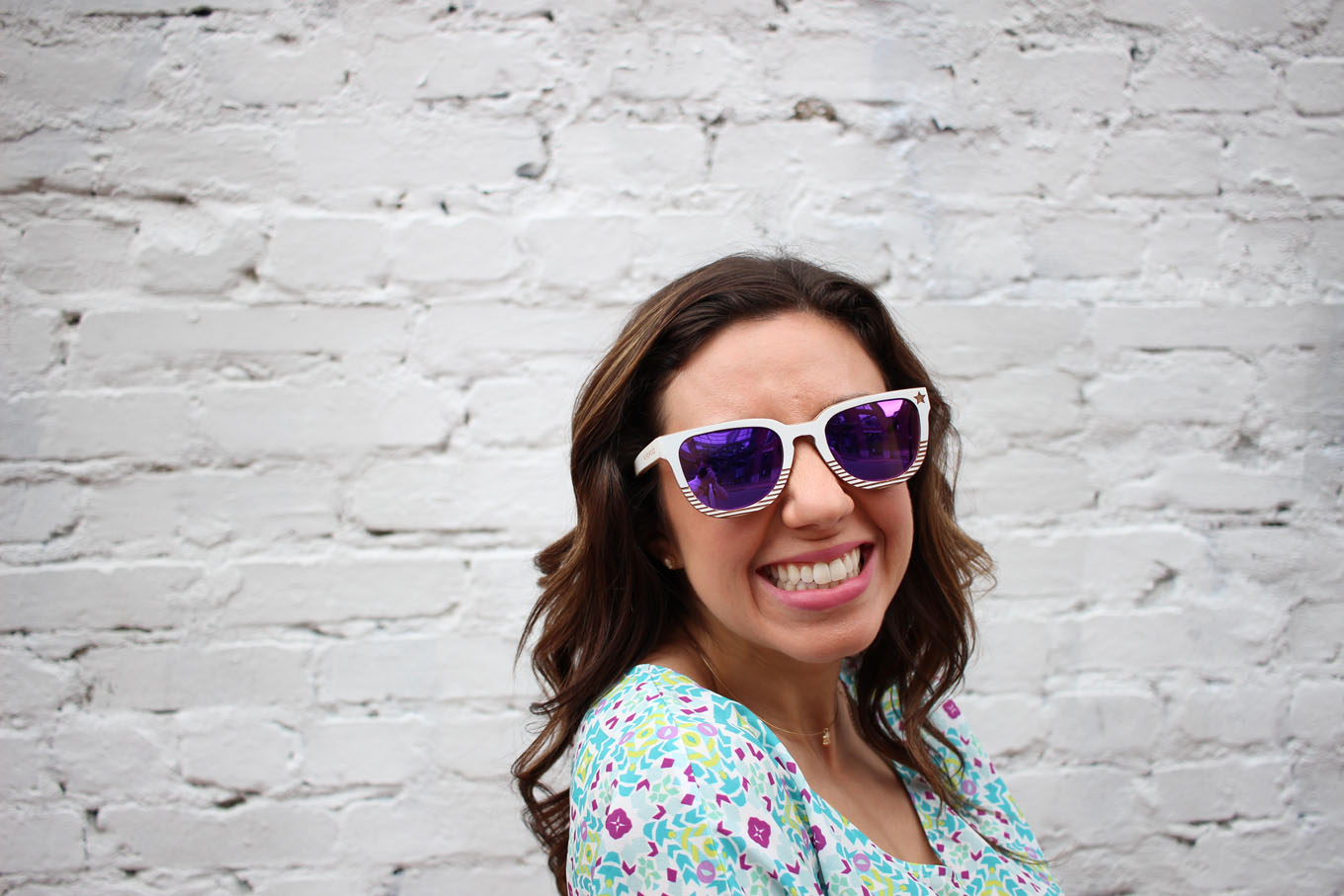 Lifestyle blogger Roxanne of Glass of Glam wearing a Cuddy Studios Romper and Winkwood Sunglasses