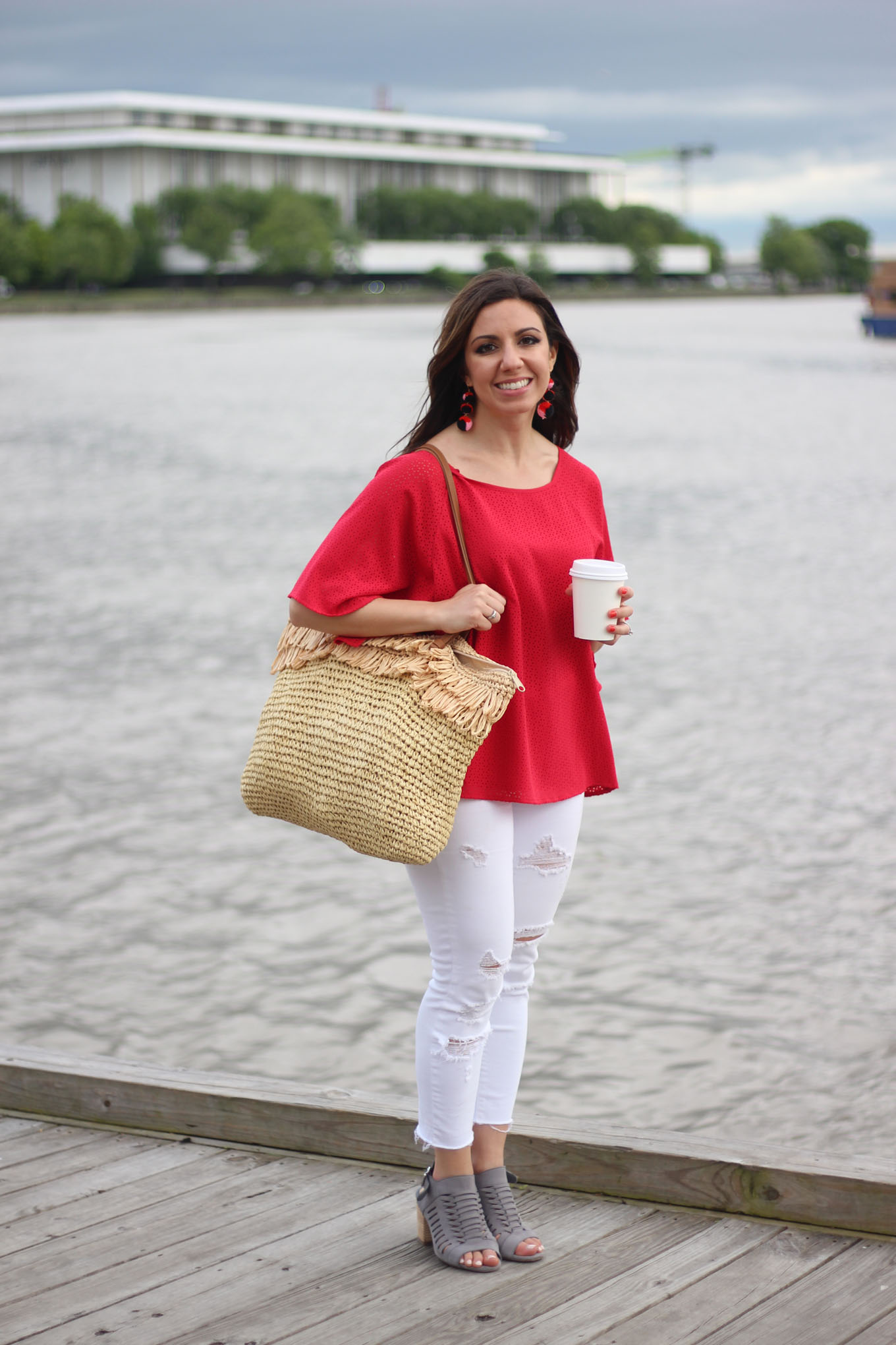 Lifestyle blogger Roxanne of Glass of Glam wearing a Cuddy Studios top, Baublebar earrings, and Old Navy Denim
