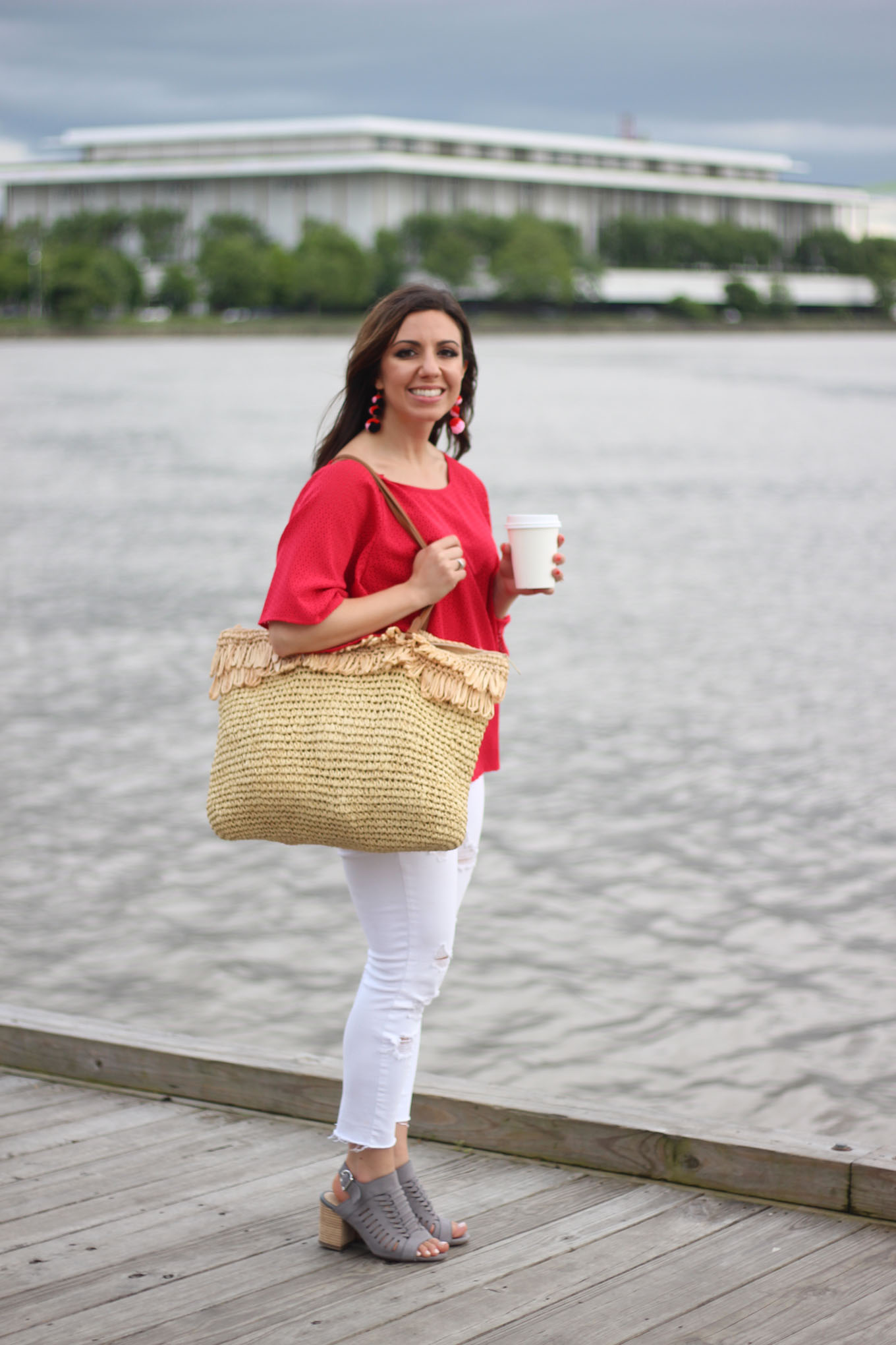 Lifestyle blogger Roxanne of Glass of Glam wearing a red Cuddy Studios top and Old Navy Denim