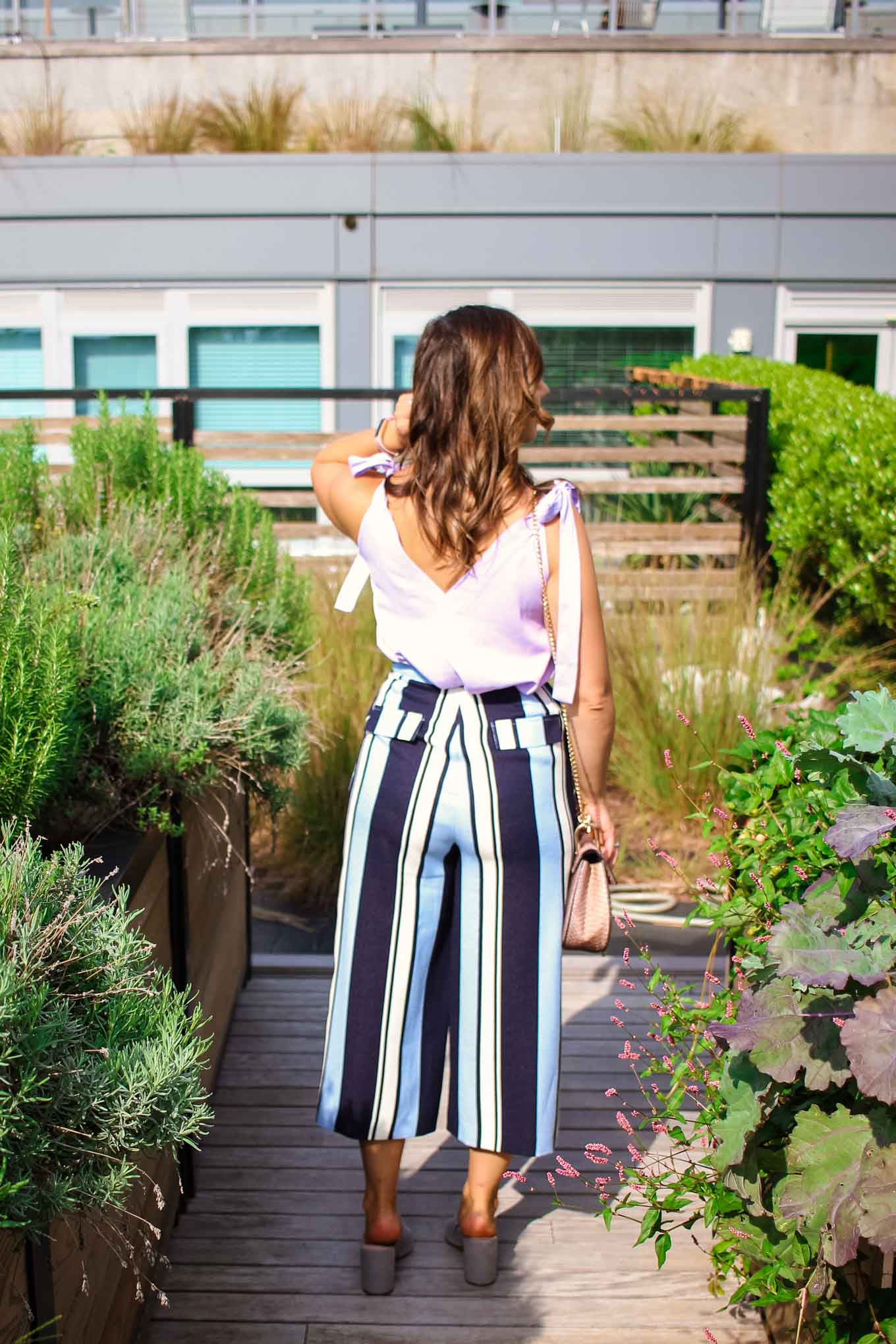 Lifestyle blogger Roxanne of Glass of Glam's striped Le Tote pants