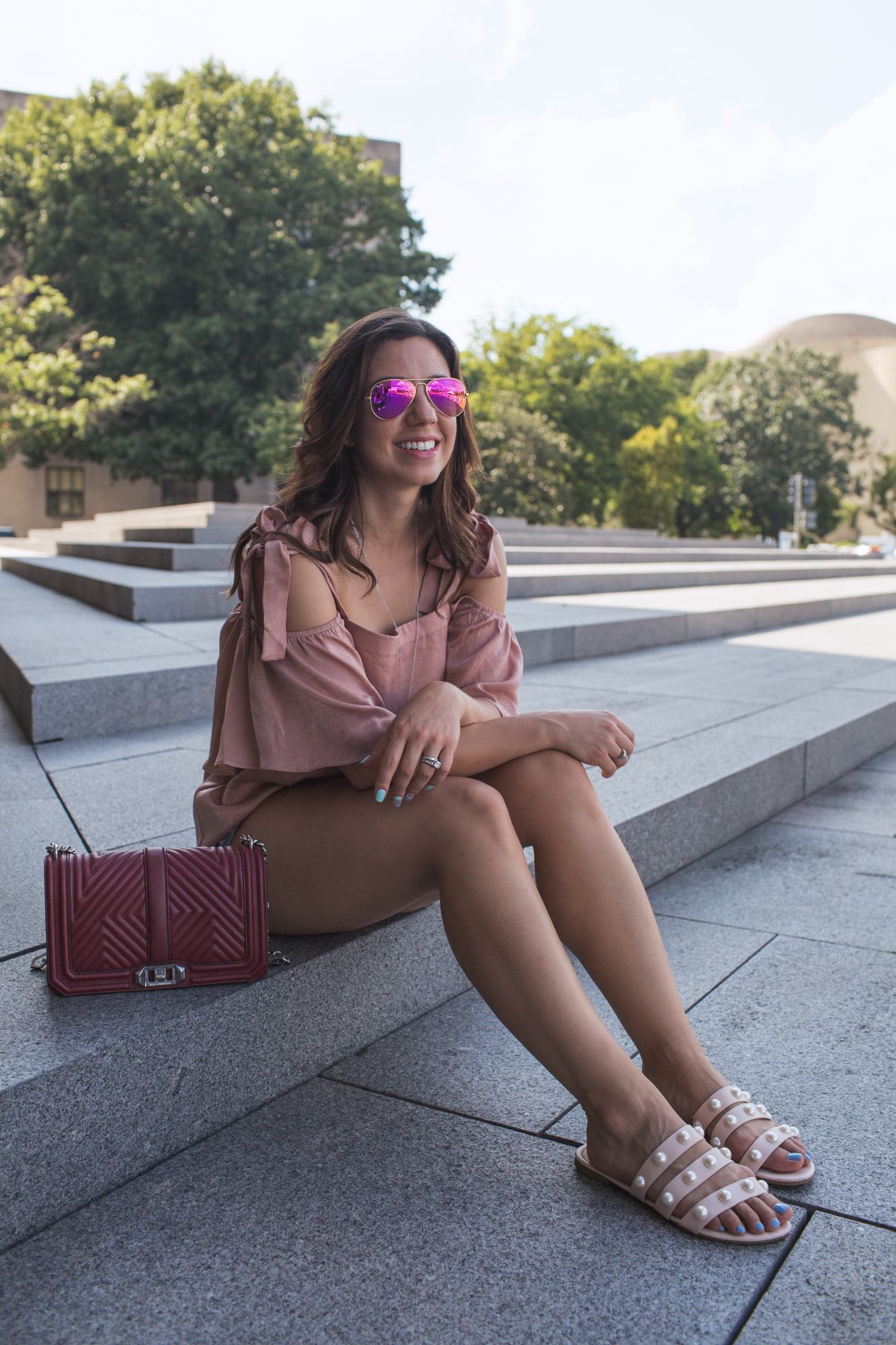 Lifestyle blogger Roxanne of Glass of Glam wearing Moonglow jewelry and a Rebecca Minkoff love bag
