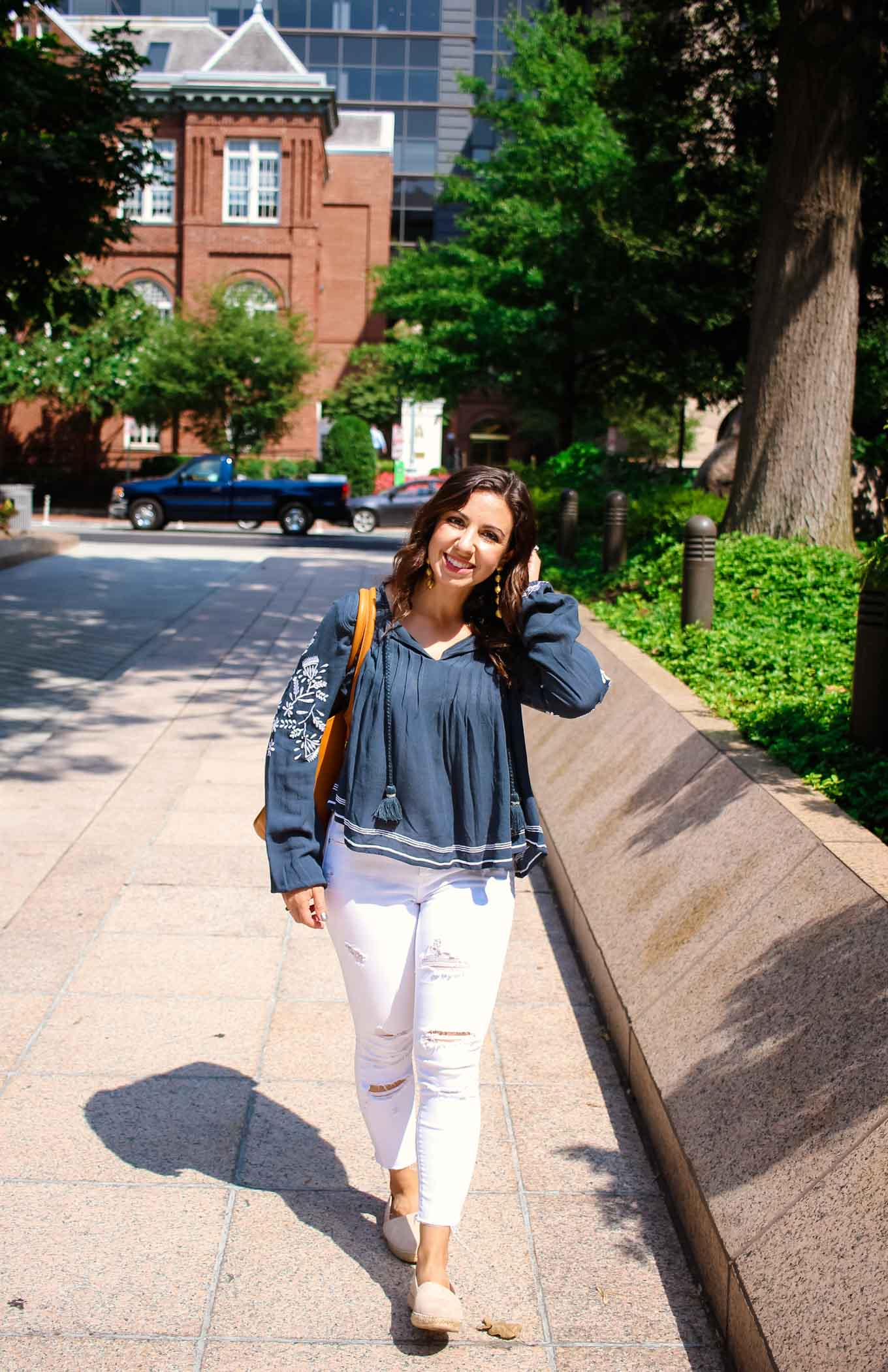 Lifestyle blogger Roxanne of Glass of Glam wearing a Tularosa blouse, Old Navy denim, 2Rivers tote, and Baublebar Earrings