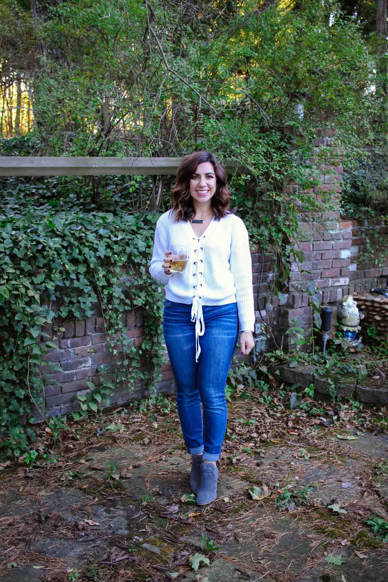Lifestyle blogger Roxanne of Glass of Glam wearing a lace up sweater, A Gold E denim, Vince Camuto booties, and a T&J Designs Necklace - Baseball Sweater by popular DC fashion blogger Glass of Glam