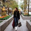 Lifestyle blogger Roxanne of Glass of Glam wearing a Target chenille sweater, Mott and Bow denim, white booties, bauble bar tassel necklace, and a Goyard bag