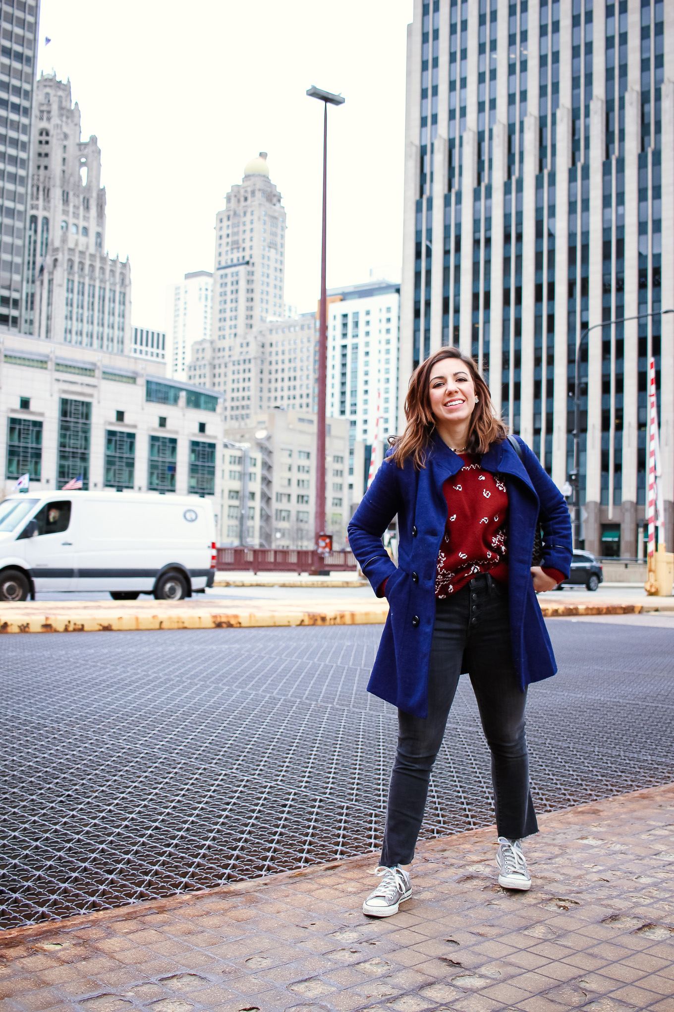 Lifestyle blogger Roxanne of Glass of Glam wearing a Madewell cropped denim, Madewell sweater, converse, a Goyard handbag, and a blue peacoat - Ain't No Party Like A Cropped Denim Party by popular Chicago fashion blogger Glass of Glam