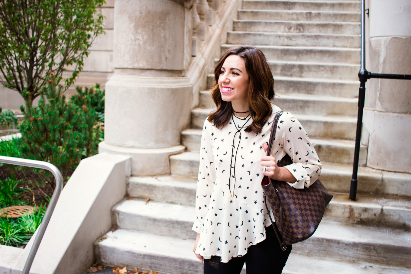 Lifestyle blogger Roxanne of Glass of Glam wearing a star print asymmetrical top, Old Navy denim, and pink combat boots - Asymmetric top with star print by popular Chicago fashion blogger Glass of Glam