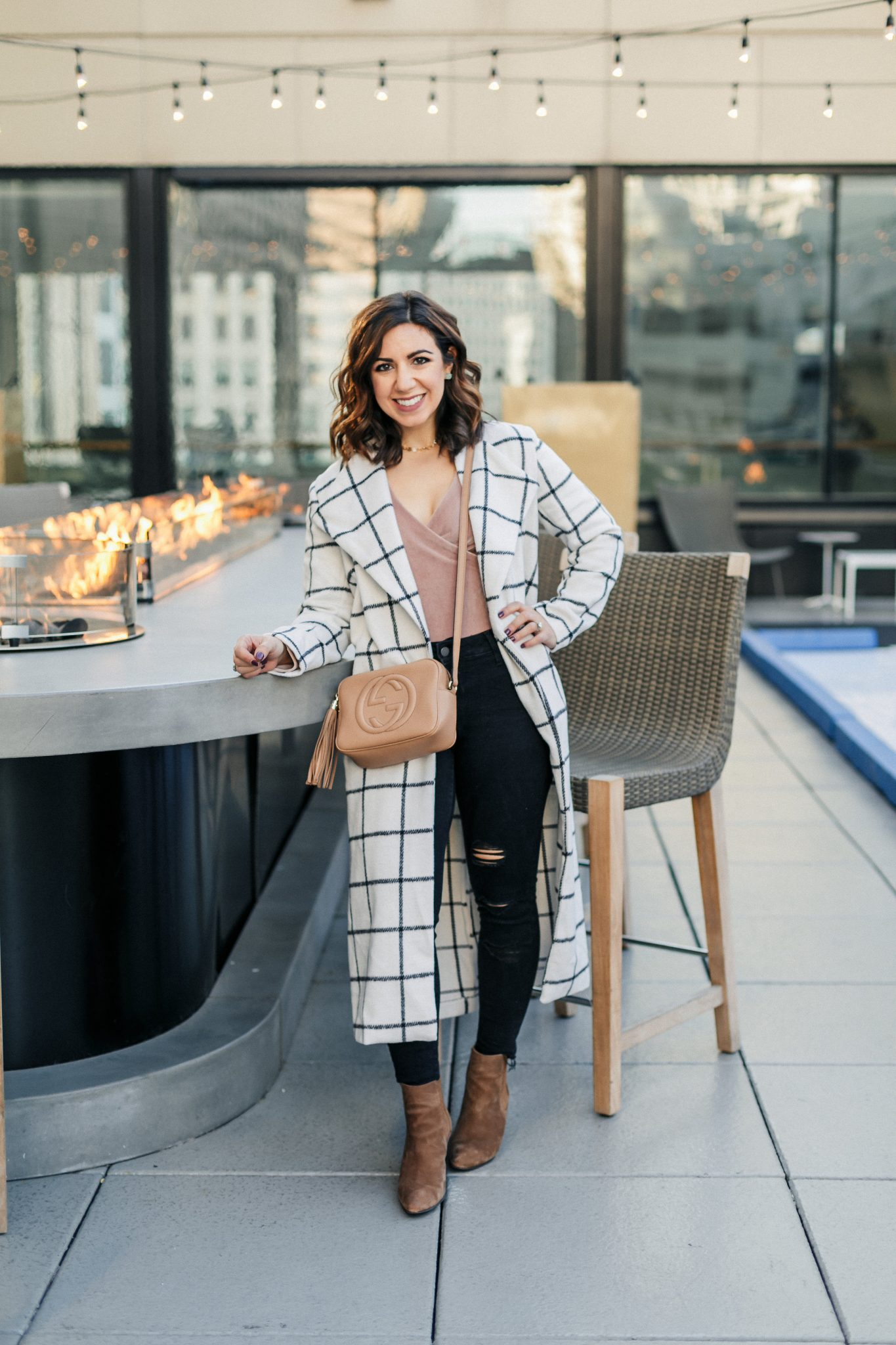 Lifestyle blogger Roxanne of Glass of Glam wearing a windowpane duster coat, velvet bodysuit, distressed denim, and a Gucci soho disco bag - SheIn windowpane duster coat by popular Washington fashion blogger Glass of Glam