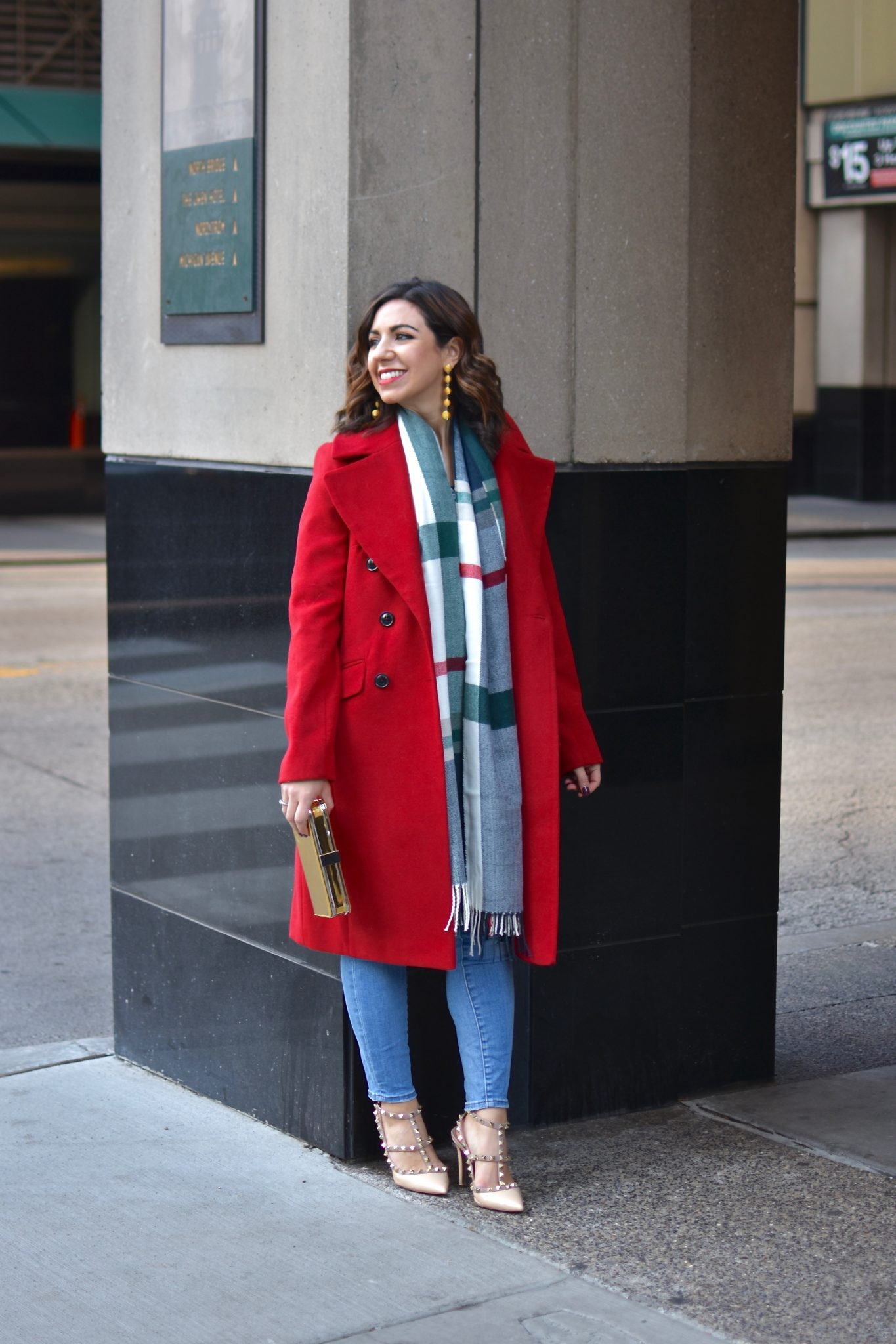 Lifestyle blogger Roxanne of Glass of Glam wearing a red ASOS coat, Valentino rockstud heels, a plaid scarf, and Madewell denim | What Being Jewish at Christmas is Like featured by top Chicago lifestyle blogger, Glass of Glam