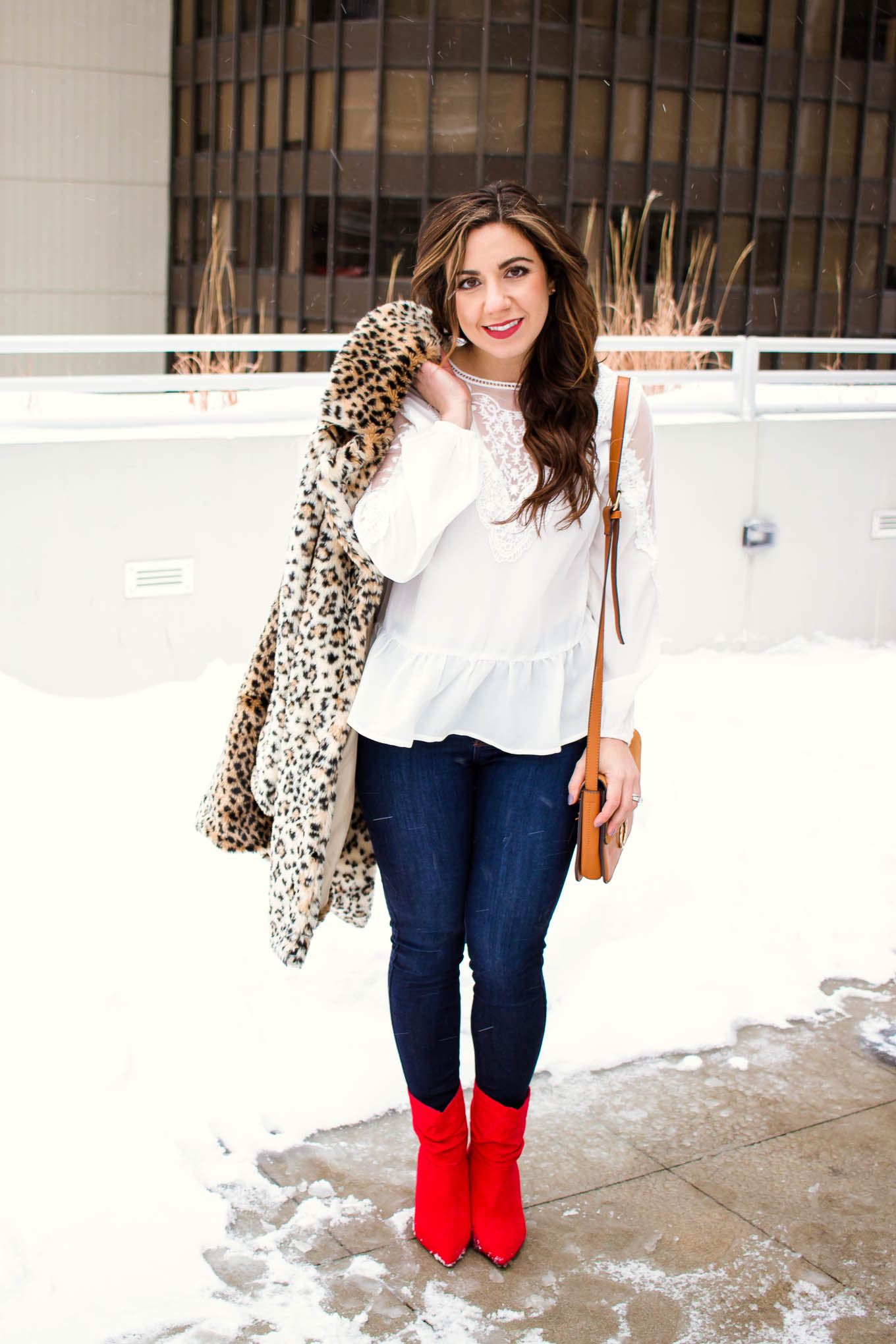 Lifestyle blogger Roxanne of Glass of Glam wearing a white lace Shein top, leopard coat, Mott and Bow denim, and red booties. - SheIn White Lace Top outfit by popular Chicago fashion blogger Glass of Glam