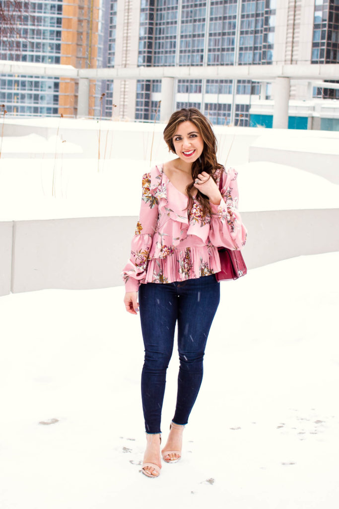 Valentines Day Outfit styled by top US fashion blog, Glass of Glam: image of a woman wearing a Leith floral top, Mott and Bow skinny jeans, JustFab heels, and a Rebecca Minkoff crossbody bag