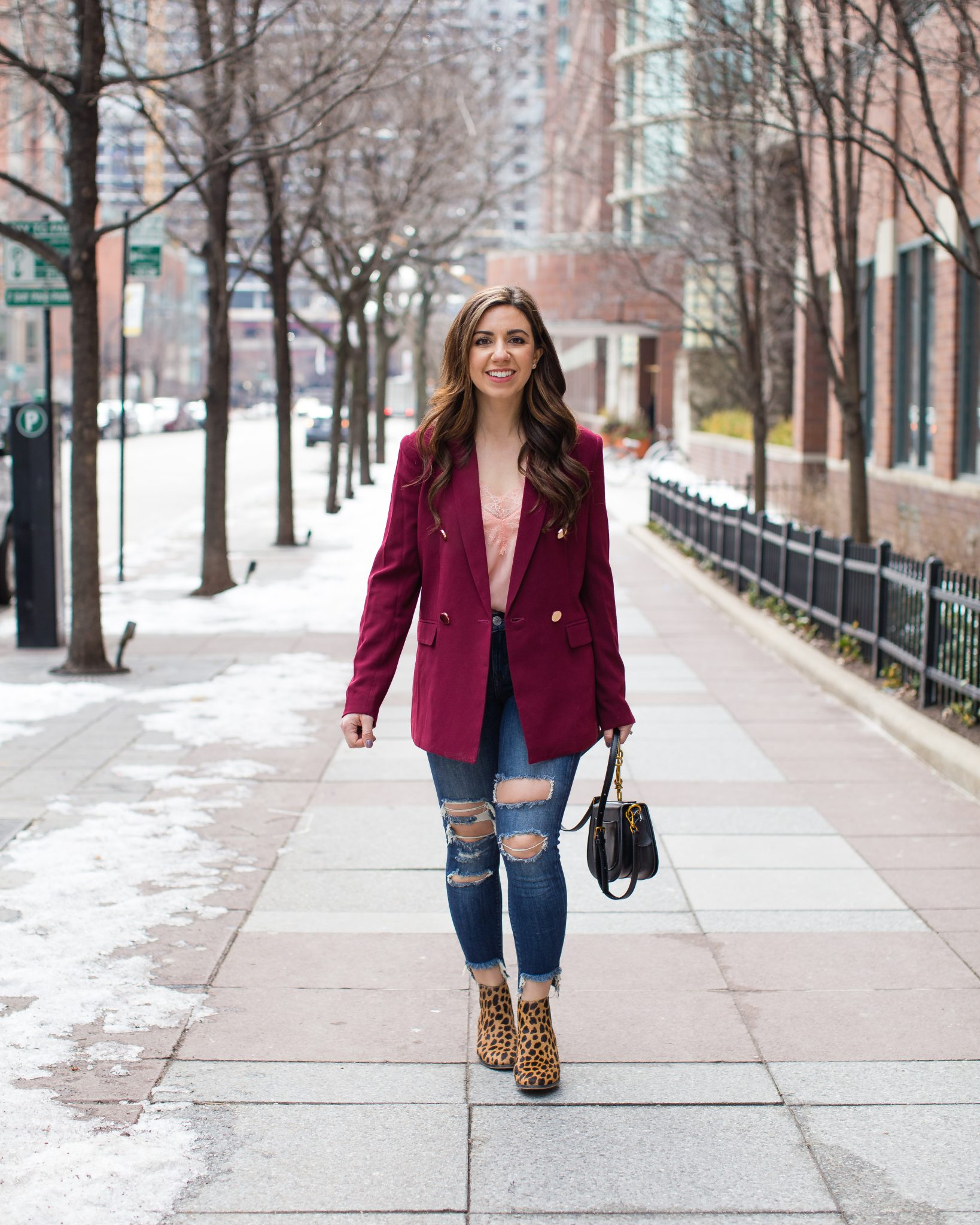 Lifestyle blogger Roxanne of Glass of Glam wearing a burgundy boyfriend blazer, Express denim, leopard booties, lace cami, and a Chloe Nile bag dupe - Nordstrom Burgundy Blazer  by popular Chicago fashion blogger Glass of Glam