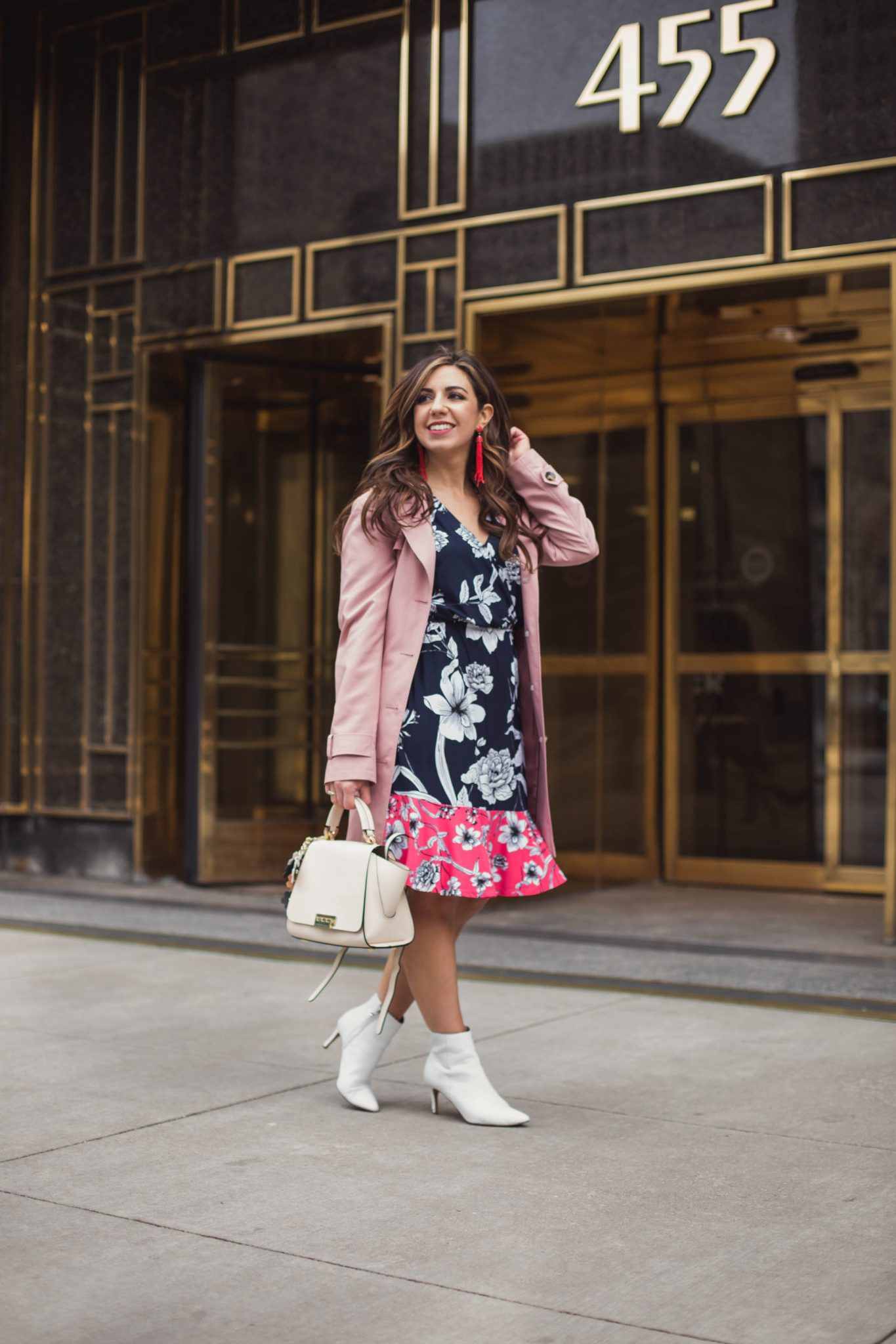 Lifestyle blogger Roxanne of Glass of Glam wearing an Eliza J dress, white booties, Zac Posen bag, and a pink trench coat - Spring Trench Coats styled by popular Chicago fashion blogger Glass of Glam
