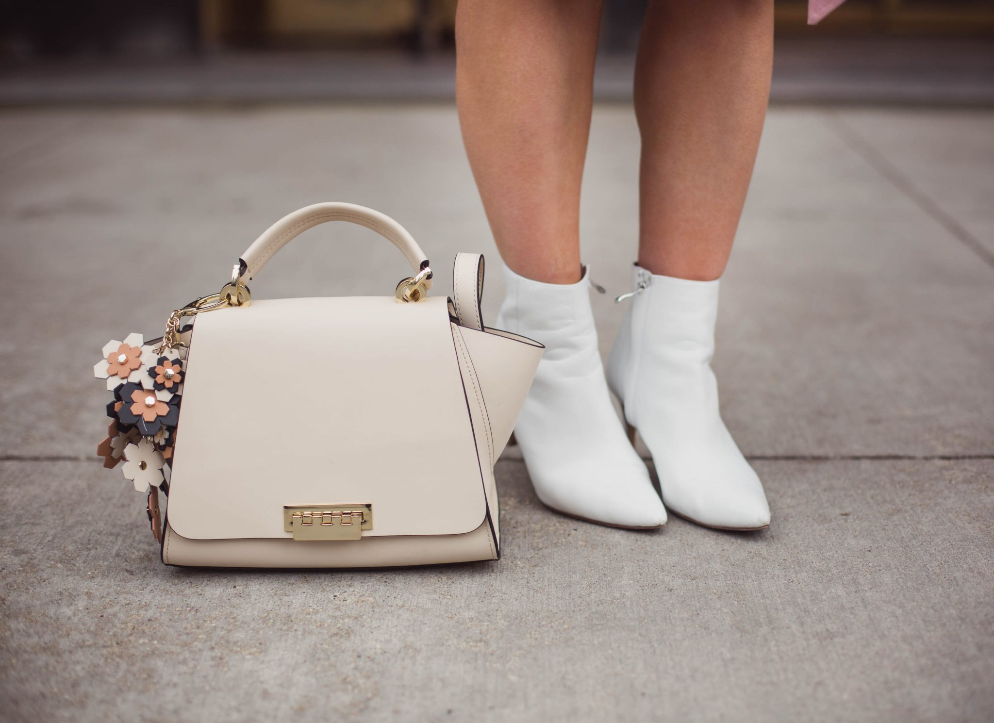 Lifestyle blogger Roxanne of Glass of Glam wearing an Eliza J dress, white booties, Zac Posen bag, and a pink trench coat