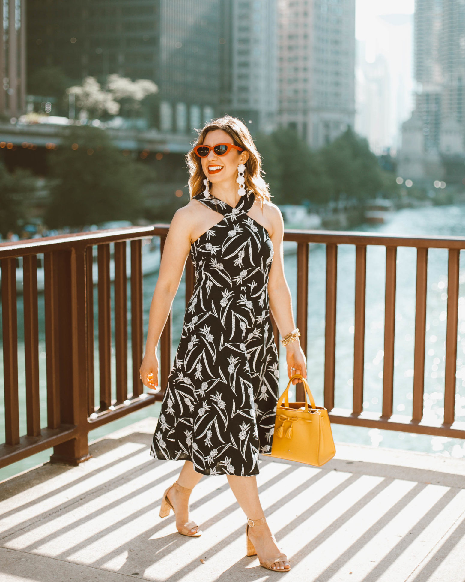 Memorial Day Weekend Deals and Sales featured by top US fashion blog, Glass of Glam: image of a woman wearing a pineapple dress