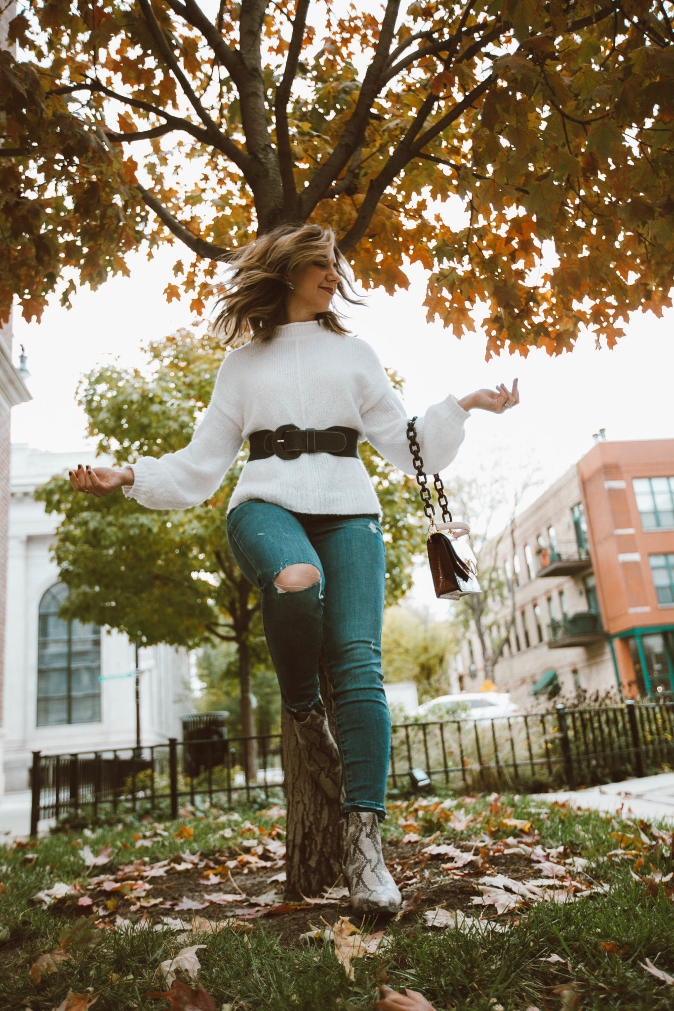Madewell distressed denim styled by top Chicago fashion blog, Glass of Glam