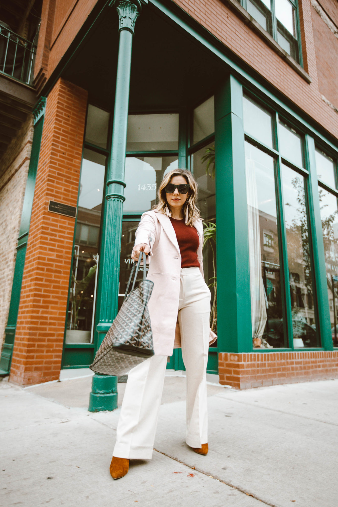 Trendy workwear featured by top Chicago fashion blog, Glass of Glam: picture of a woman wearing Chadwicks pants, Chadwicks coat and Chadwicks sweater, Steve Madden booties, Goyard bag and Quay sunglasses