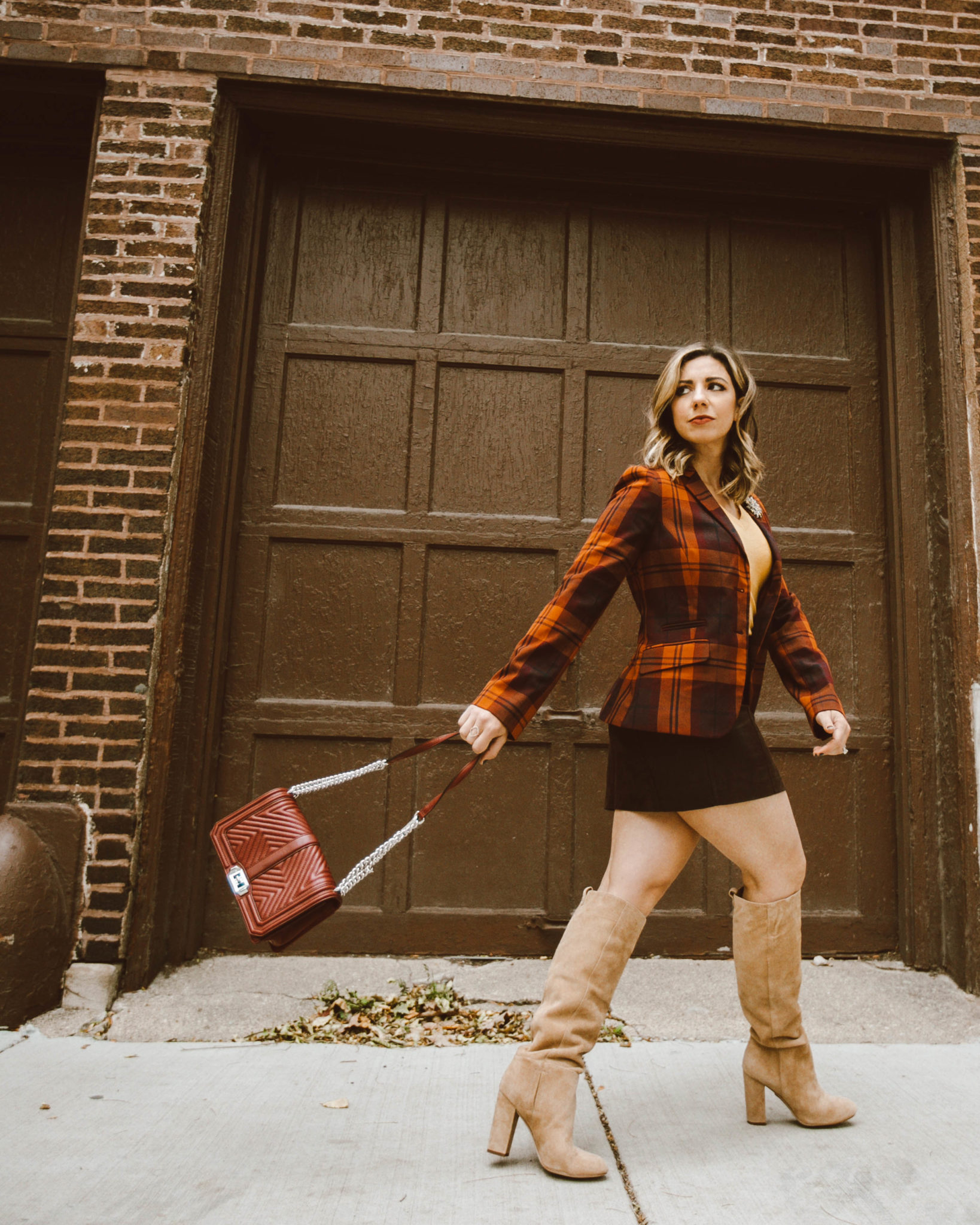 Mini Skirts for Fall Under $50 & On Mondays We Link Up by popular Chicago fashion blog, Glass of Glam: image of a woman wearing a fall mini skirt.