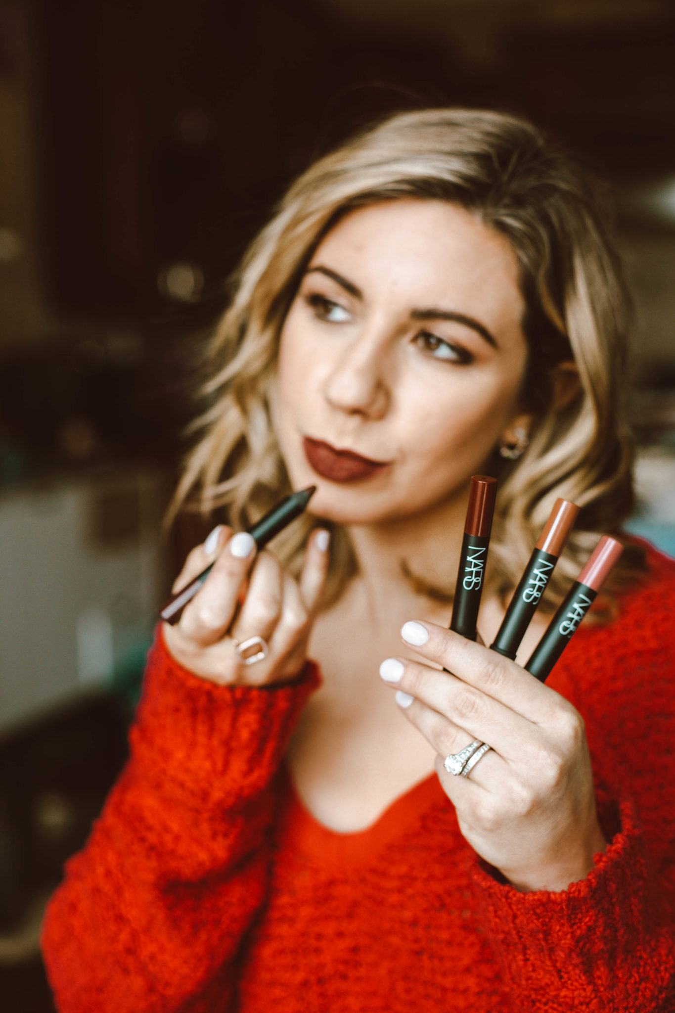 Beauty Gift Ideas featured by top Chicago beauty blog, Glass of Glam: image of a woman trying on NARS lip pens