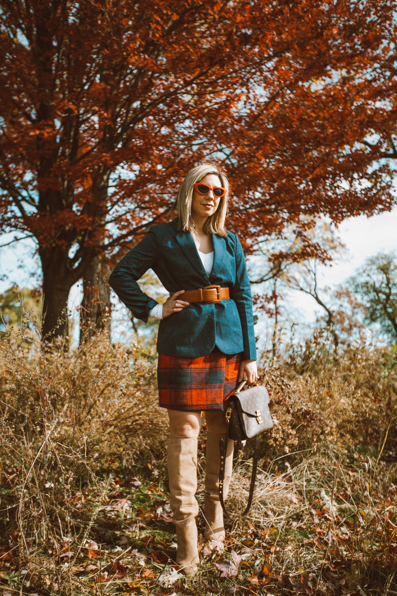 SheIn Winter Picks featured by top US fashion blog, Glass of Glam: image of a woman wearing a SheIn paid skirt, BP V Neck tee, Sam Edelman knee high boots, Halogen stretch belt, Chadwicks of Boston boyfriend blazer, Louis Vuitton bag and ASOS cat eye red sunglasses