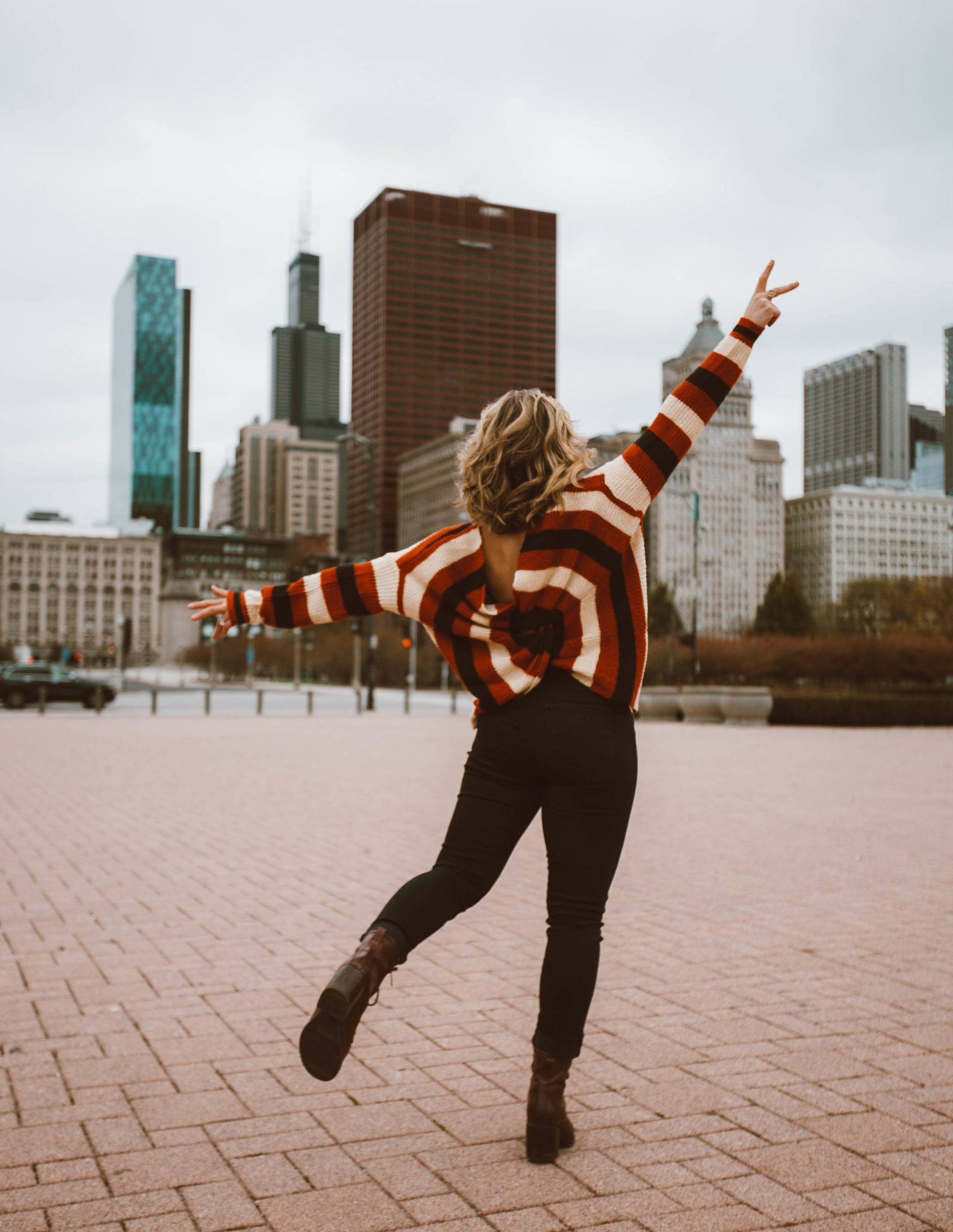 Thanksgiving Outfit Ideas featured by top Chicago fashion blog, Glass of Glam: blonde woman wearing VICI sweater, Liverpool jeans, Patricia Nash boots, Option for Less Liptstick