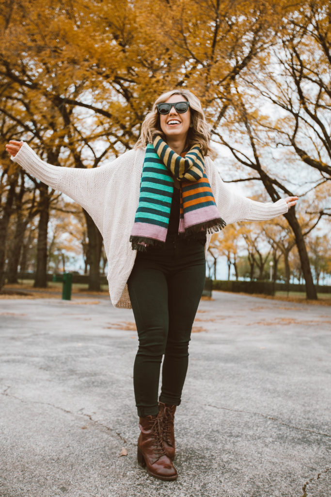 Anderson sunglasses featured by top Chicago fashion blog, Glass of Glam: woman in a park wearing Anderson sunglasses, Vici cardigan, Vici lace cami, Vici blanket scarf, Liverpool legging jeans, Patricia Nash booties
