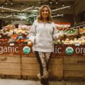 Winter activewear featured by top US fashion blog, Glass of Glam: image of a woman at a grocery store wearing Thread & Supply fleece pullover, Joriki leggings, Sorel boots