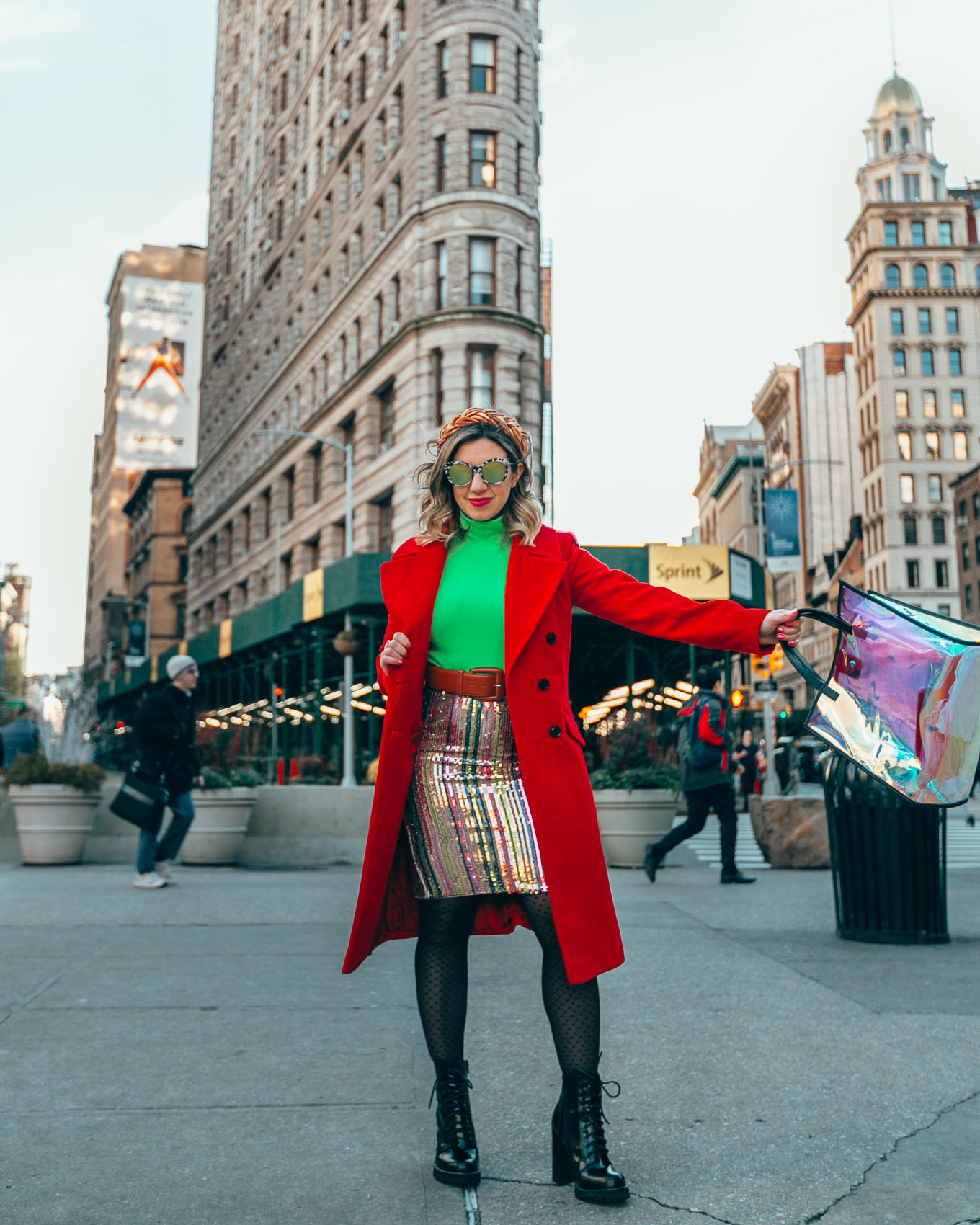 NYFW outfits featured by top US fashion blog, Glass of Glam: image of a woman wearing a neon turtleneck, a LEITH rainbow sequin skirt, n ASOS holographic shopper bag, Berkshire pattern tights, an ASOS red coat, Jeffrey Campbell booties, Etsy braided headband, Nordstrom rack sunglasses