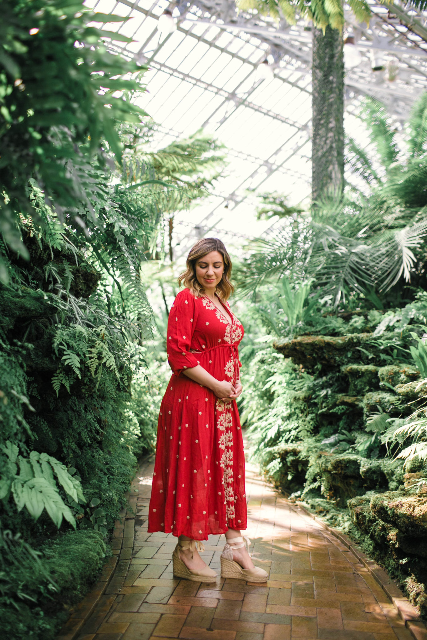 Top US life and style blog, Glass of Glam, features the gender reveal for their first baby: image of a woman wearing a Free People red embroidered midi dress and Castaner wedge espadrilles
