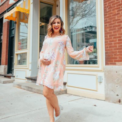 The Best shops to shop for cute maternity clothing featured by top US fashion blog, Glass of Glam: image of a pregnant woman wearing a Pink Blush maternity dress, Naturalizer toe pumps, BaubleBar drop earrings, GUCCI leather bag, and Target pearl bobby pins